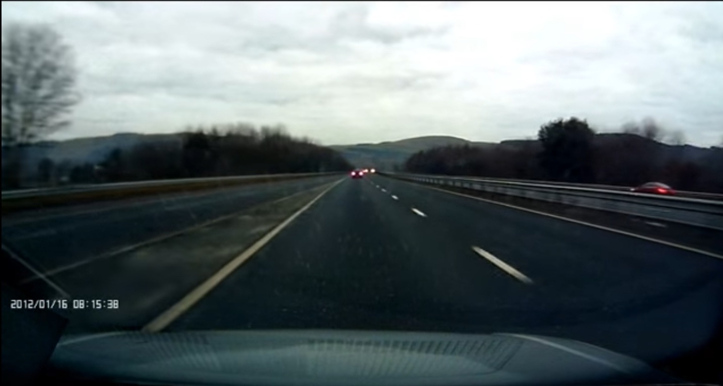 Dashcam footage captures the red Mercedes on the slip road leading to the northbound M90 at Bridge of Earn.