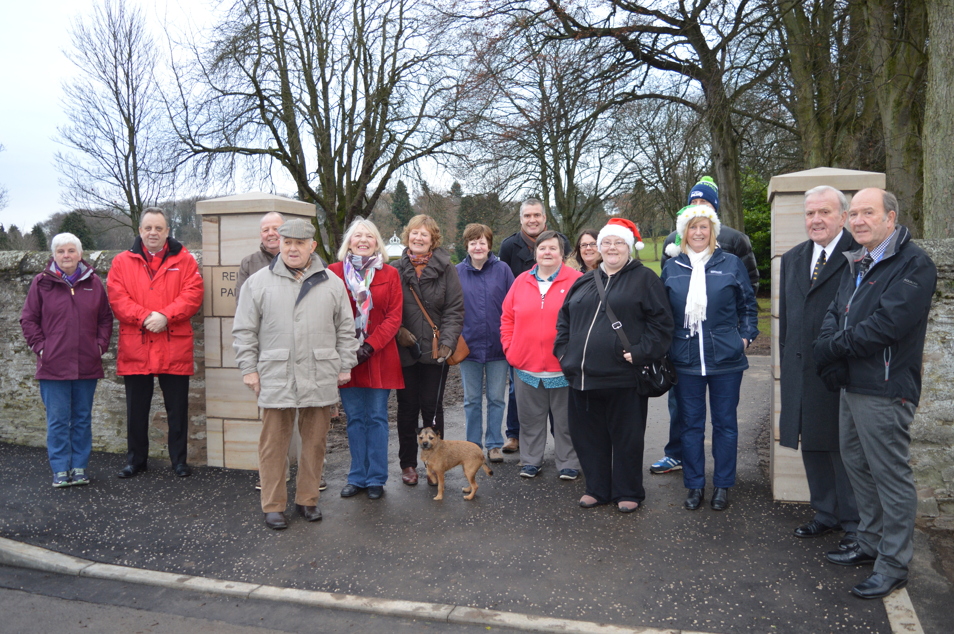 Councillors and local residents gather to inspect the scheme's progress