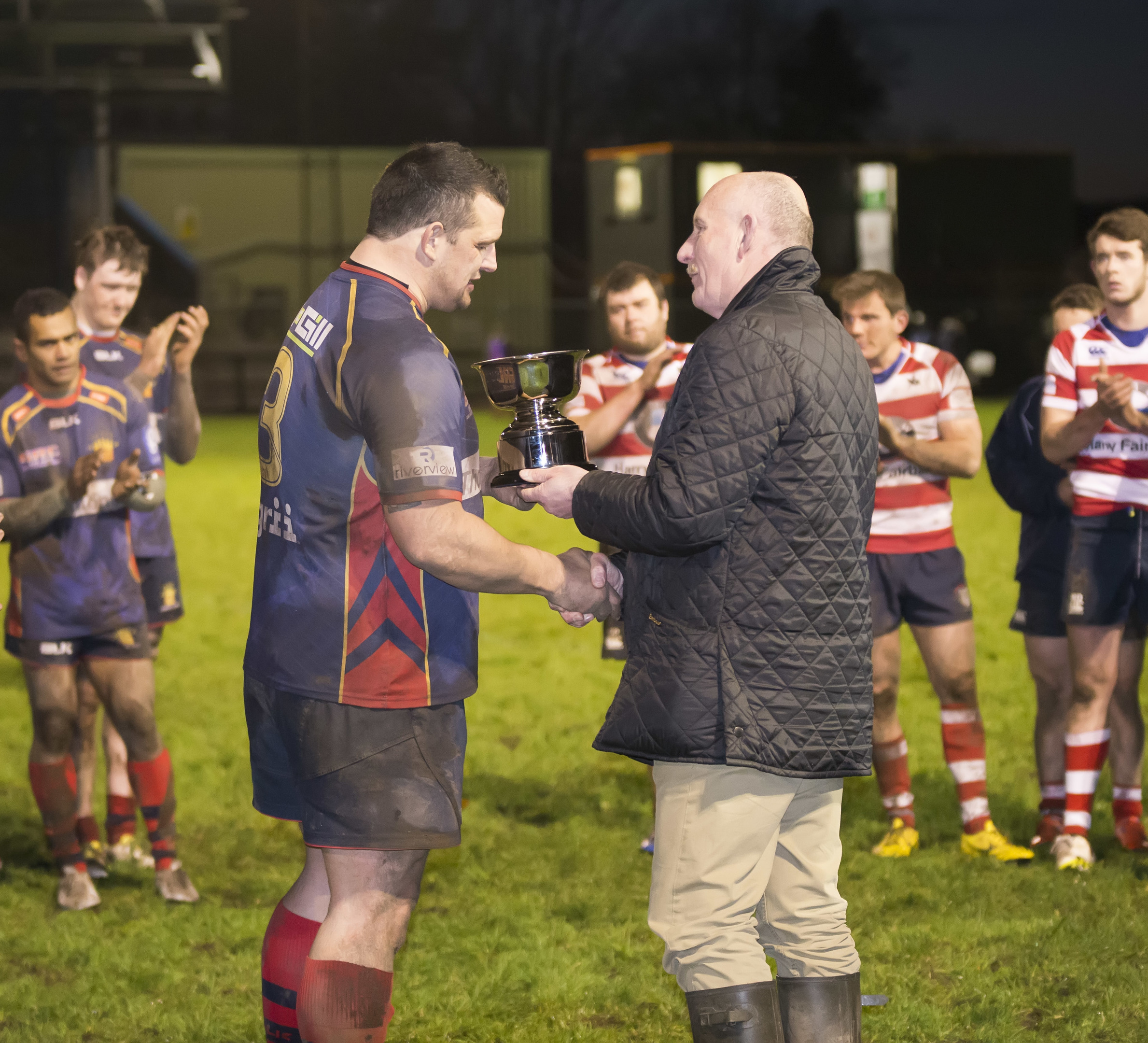 Ian Rankin presents the Rankin Bowl to Dundee HSFP skipper Alan Brown after last year's clash between the teams at Duffus Park.
