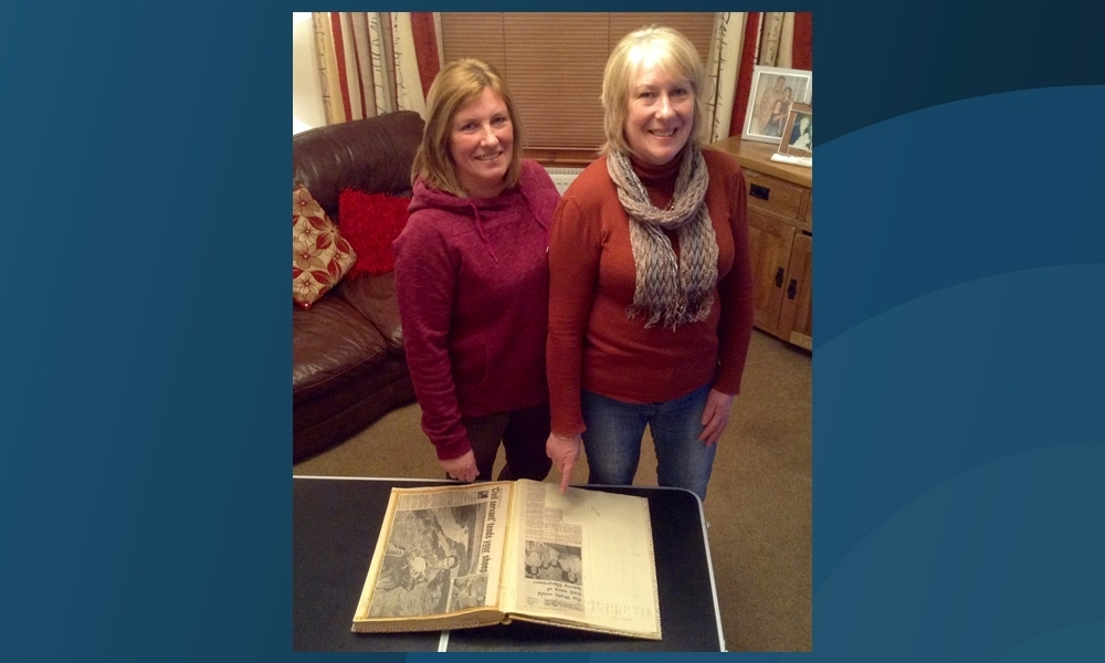 Ann Stewart and Lynn Orrock recalling an article about their family which appeared in The Courier in 1969. The cutting is part of a fascinating journal of the Watt familys life in Glen Prosen.
