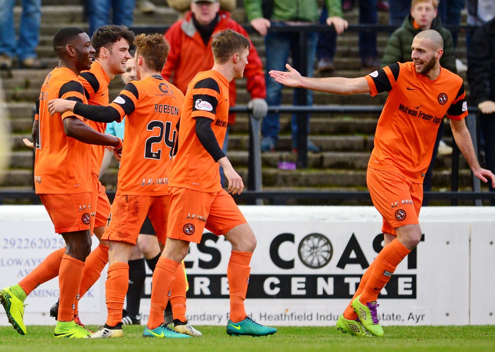 Tope Obadeyi (left) and his colleagues celebrate his goal.