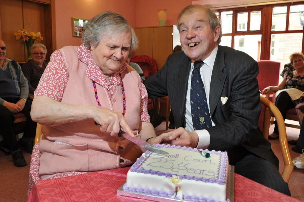 Lord Lyell with resident Annie Robertson at the 25th anniversary of the Lyell Court sheltered housing complex in Kirriemuir in 2012.