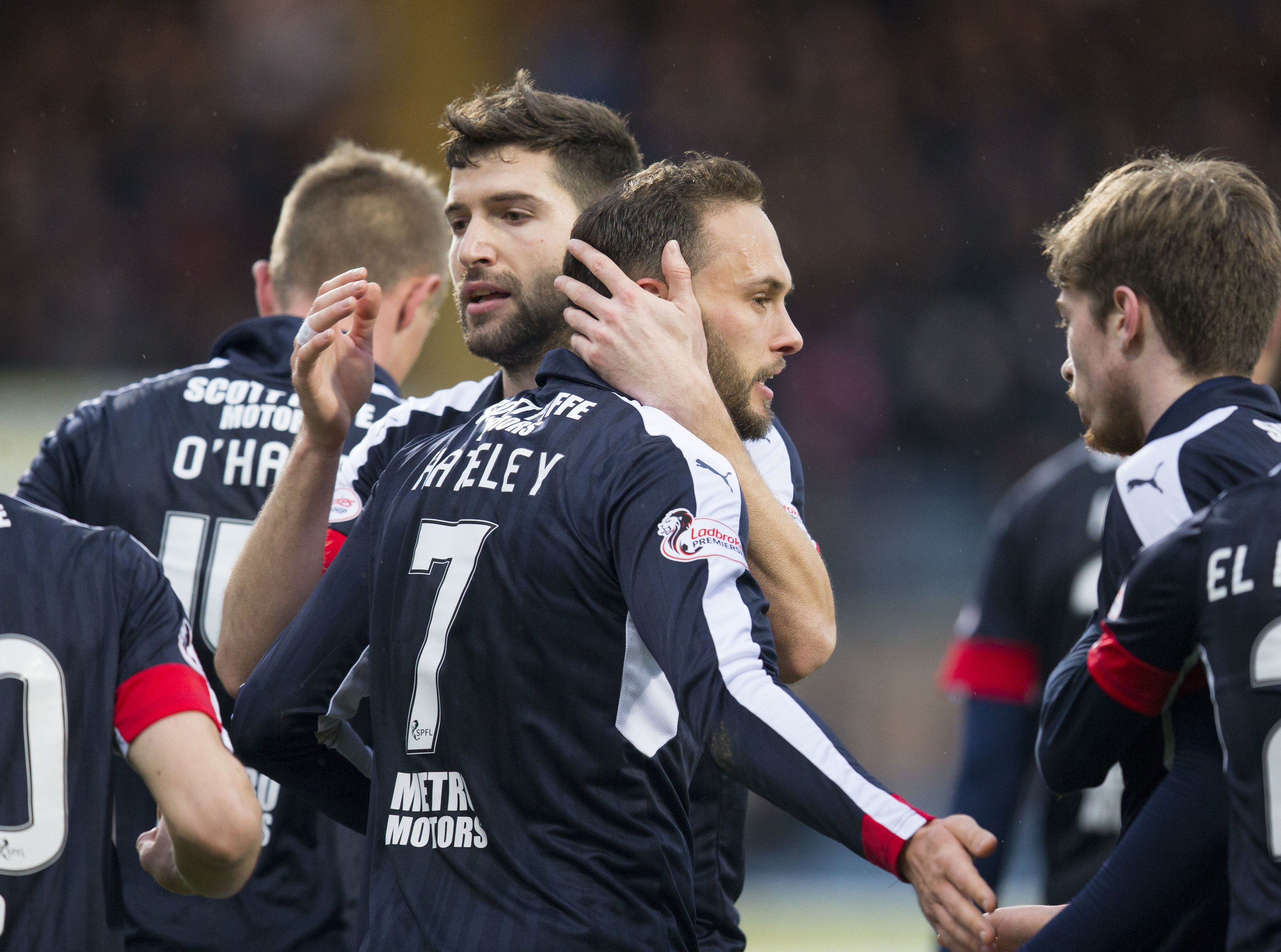 The Dundee players were celebrating a three-goal win in their last league game.