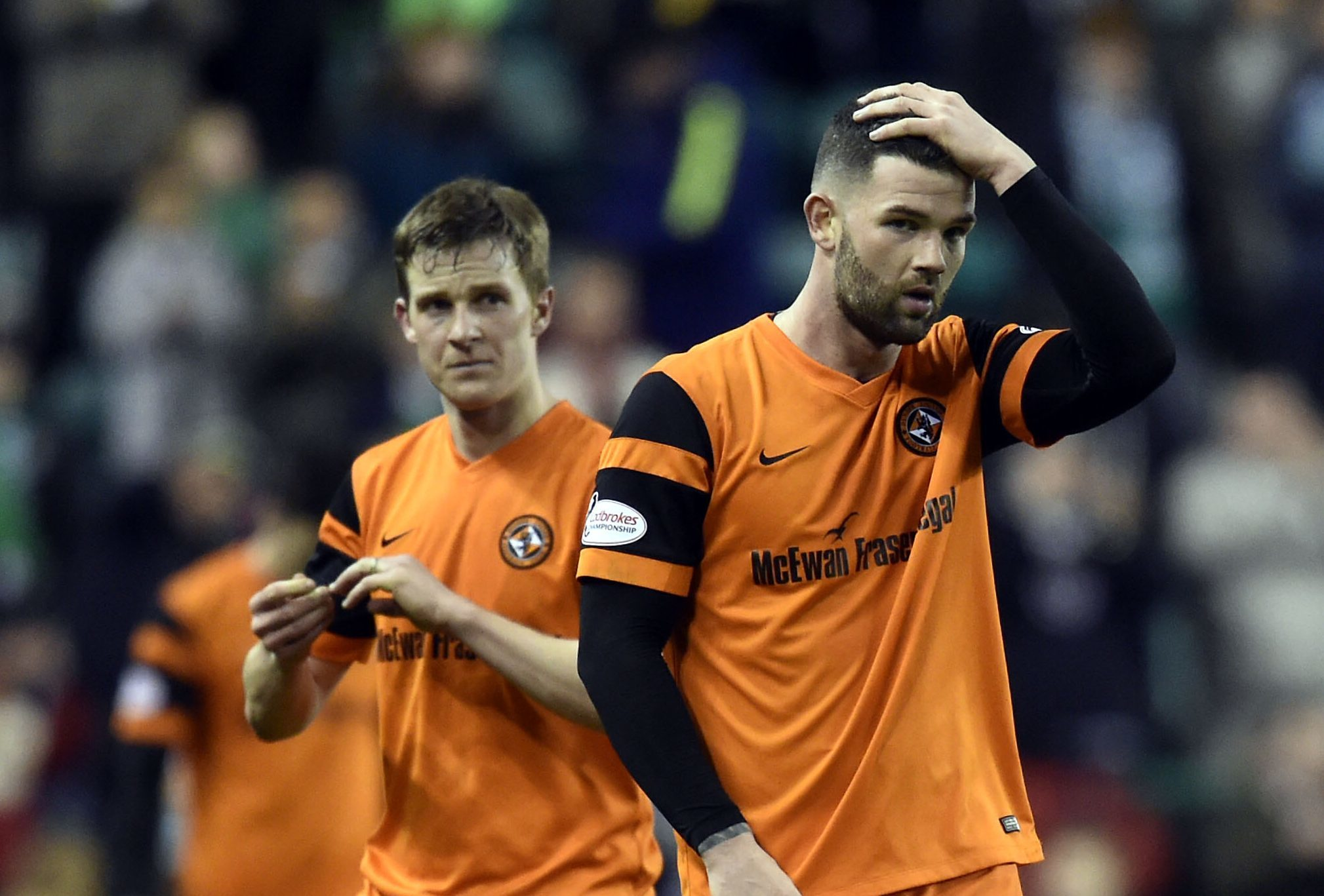 Dejection for Dundee United's Paul Dixon and Scott Fraser at Easter Road.