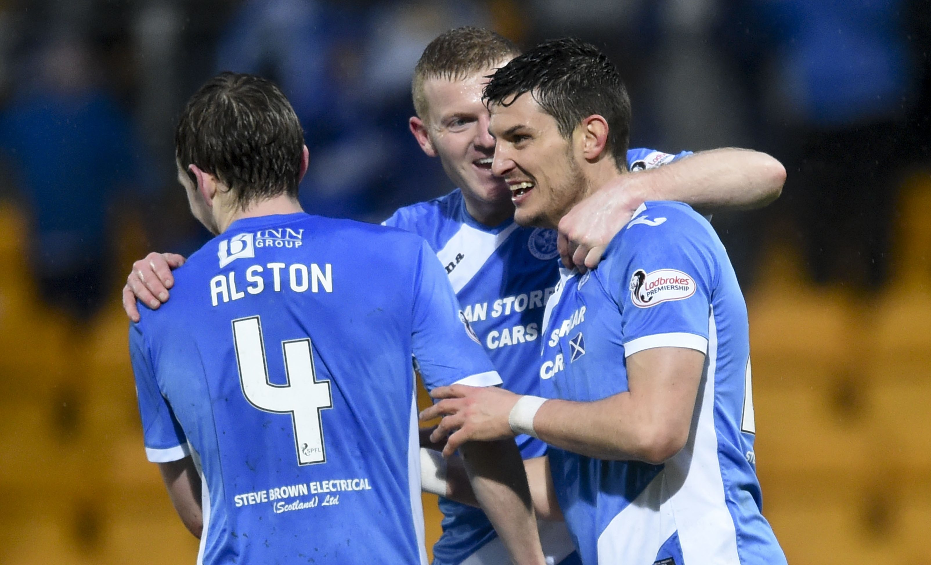 St Johnstone's Graham Cummins (right) celebrates his second goal with his team-mates.
