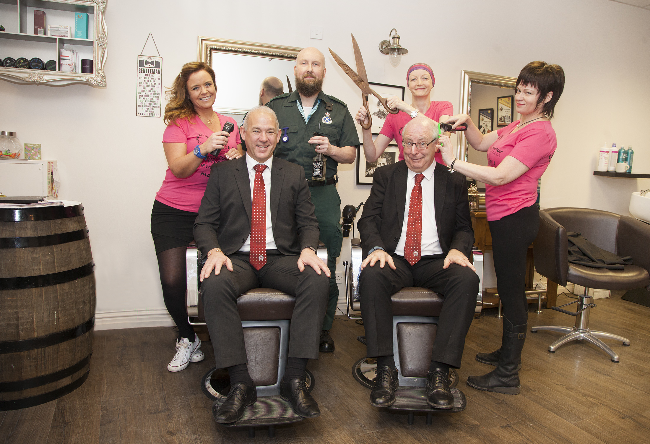 Marie Church (left) and Linda Cook (right) with Ed and Geraldine Williams and sitting getting the full treatment are Brechin City's Safety Officer Gary Ross and Vice Chairman Martin Smith.