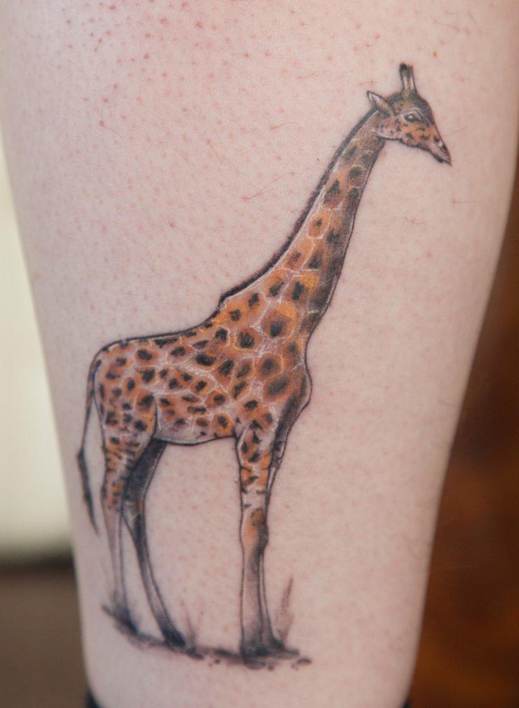 Stuart Scott from Arbroath with tattoo of a giraffe on his leg