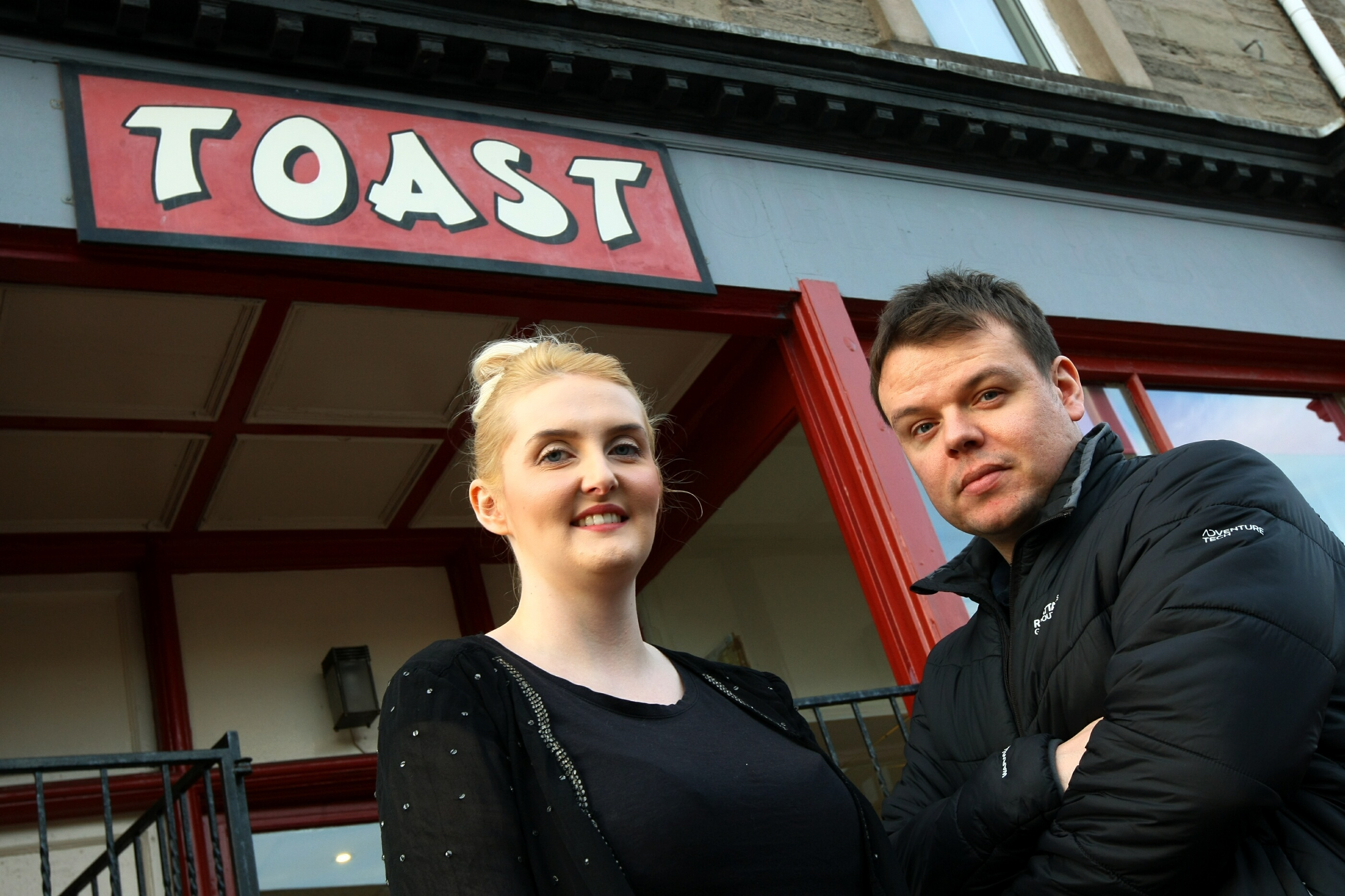 Manager Steve Sinclair, and waitress Steph Hayes, outside Toast.