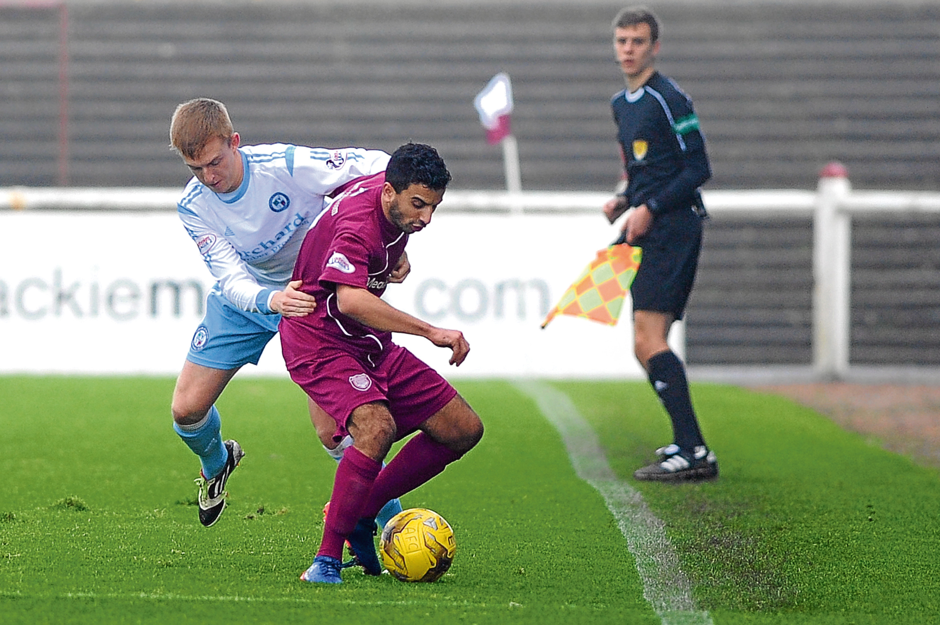 Michael Kennedy (Forfar) and Omar Kader (Arbroath) tangle in a tussle between the clubs earlier in the season.