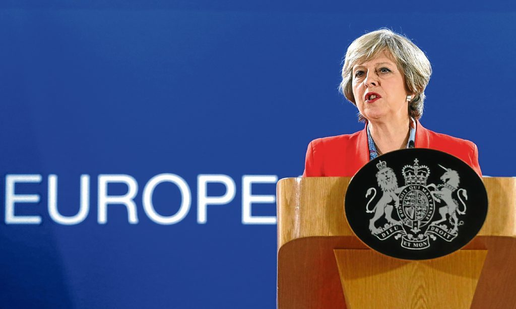 Theresa May answers questions during a press briefing in Brussels in October.