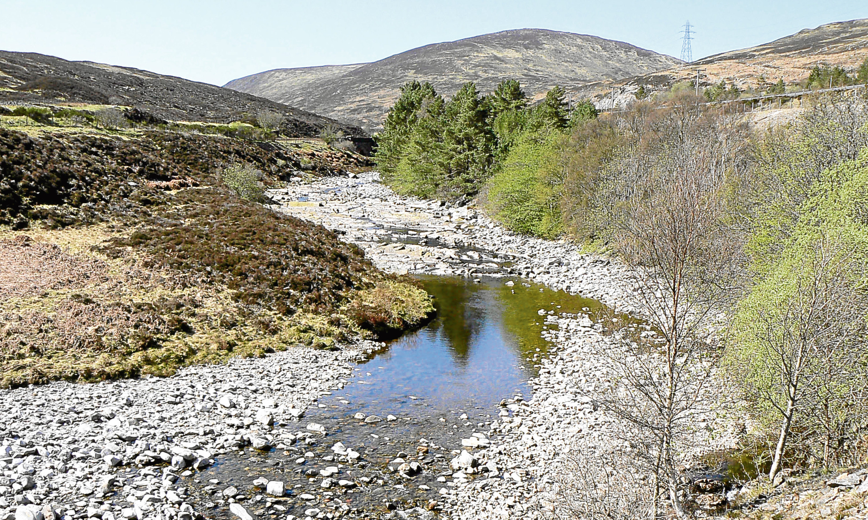 The dried-up bed of the River Garry in Perthshire, a tributary of the Tay.