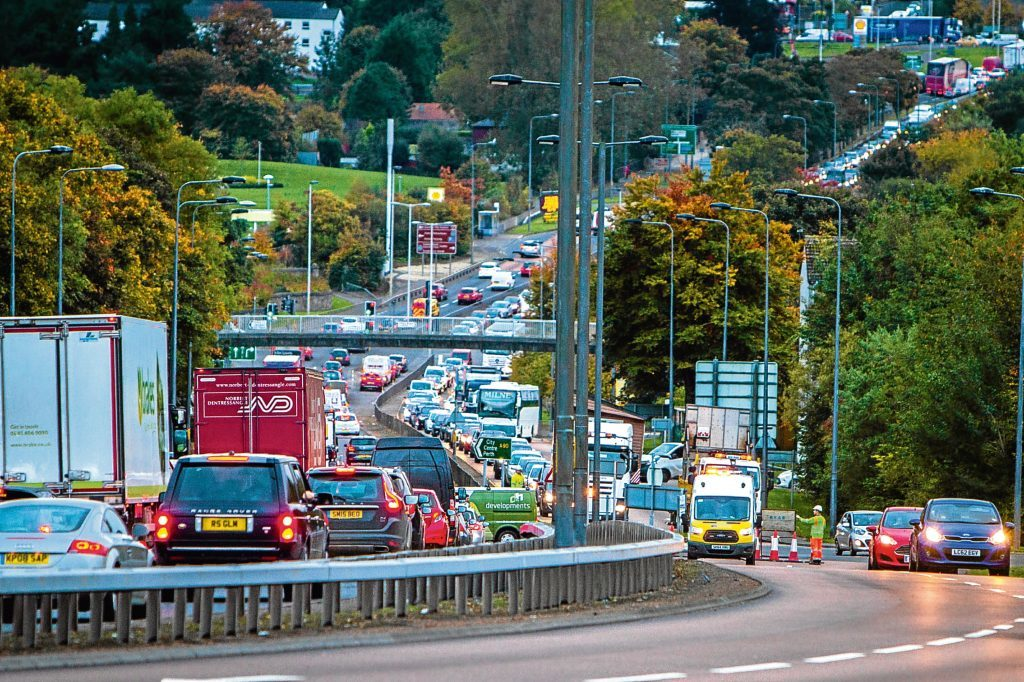 Queuing traffic in both directions at the Fintry Drive junction with Forfar Road, Dundee.