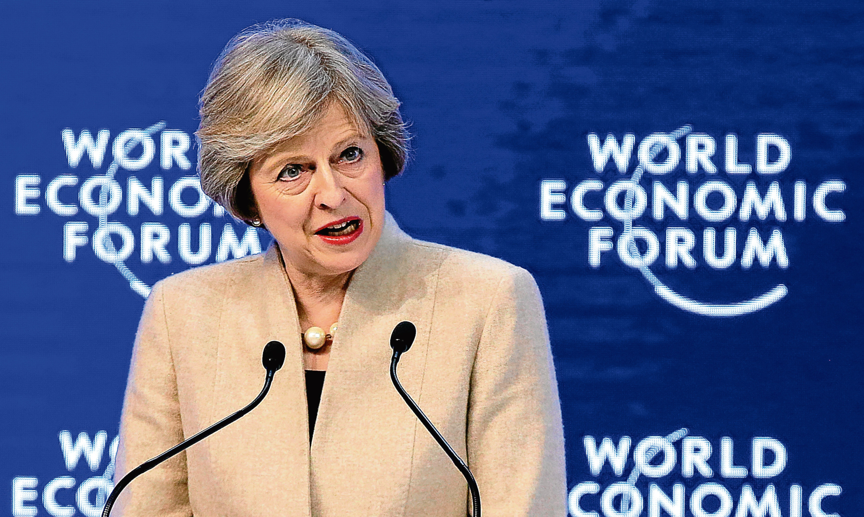 Prime Minister Theresa May addresses leaders at the World Economic Forum in Davos