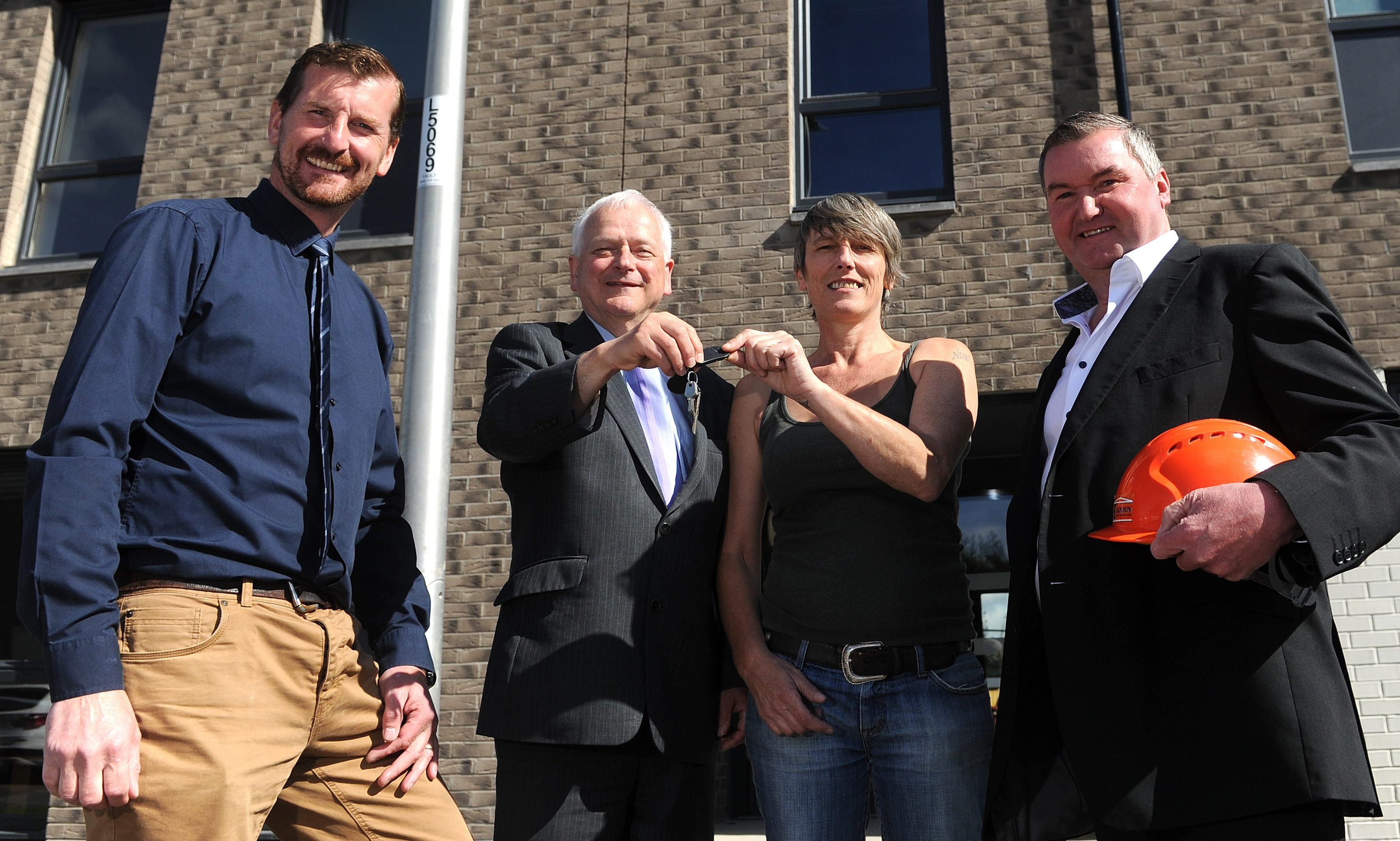 Councillor Dave Doogan (Perth and Kinross Council Convenor of the Housing Committee), Councillor Ian Miller (Perth and Kinross Council Leader), Nicola Davidson (new tenant) and Scott Hadden (Chairman of Hadden Construction), at the launch of new council homes in Springbank Road, Alyth.