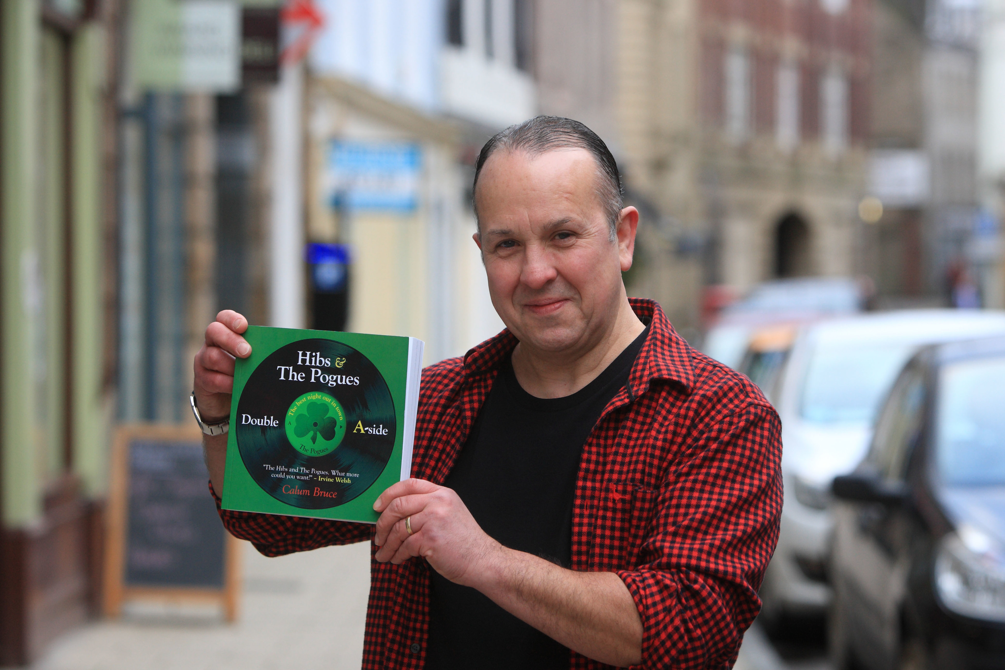Author Calum Bruce with his new book Hibs and the Pogues.