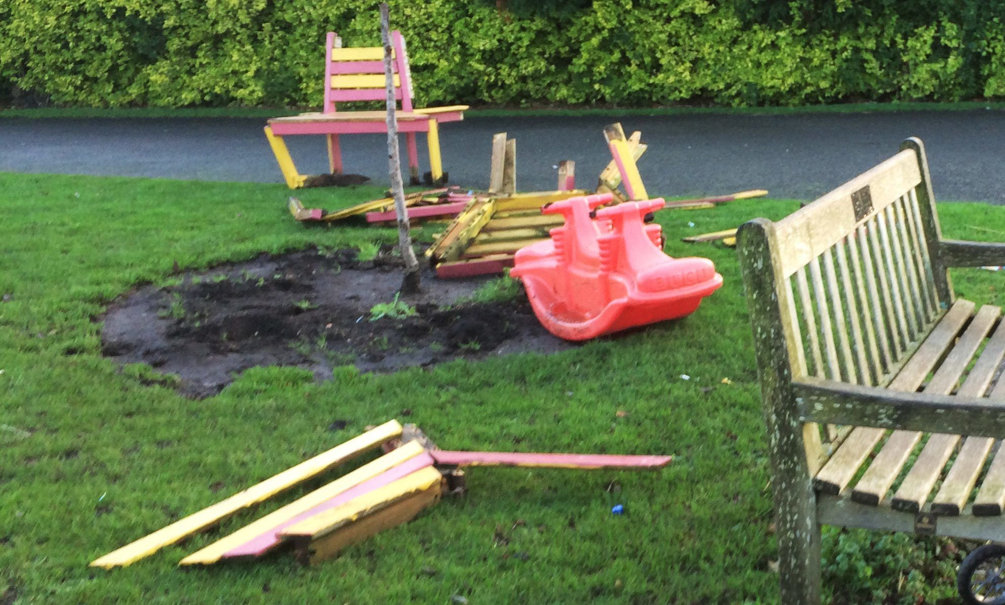 Vandals destroyed a bench, ripped out plants and left only a stalk of the tree in the garden.