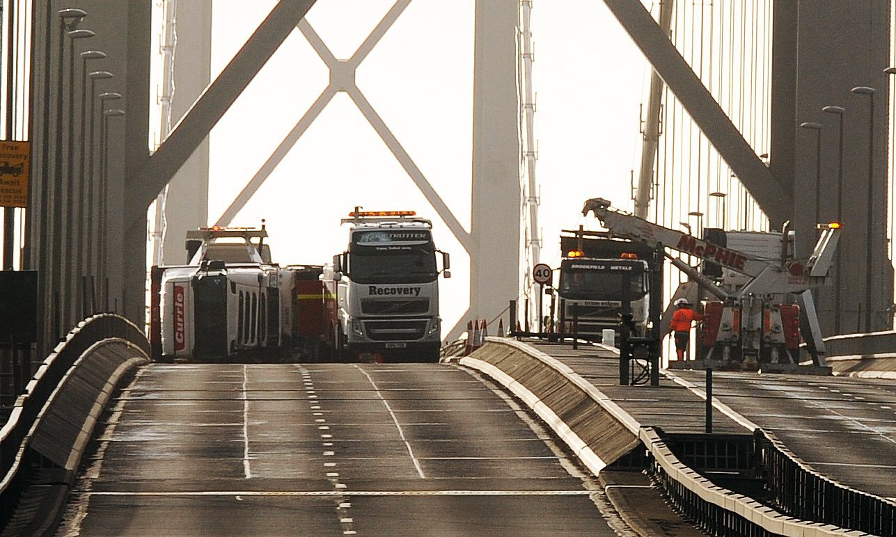 The lorry on its side on the Forth Road Bridge last week.