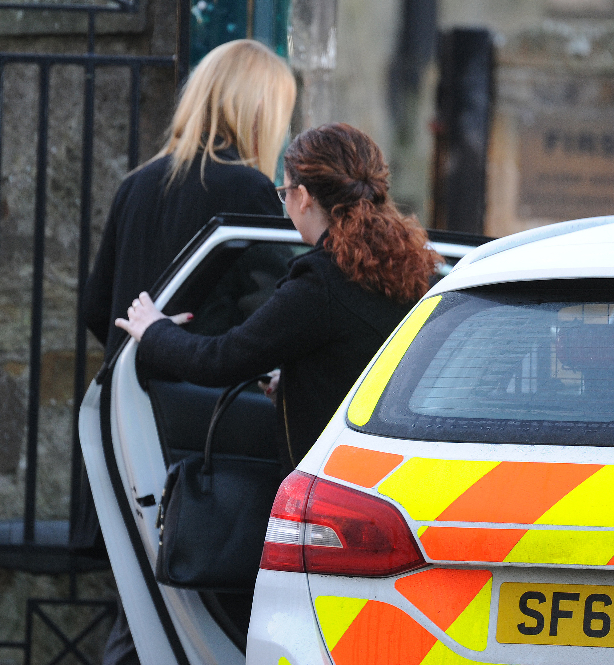 Nicole Short, seen getting out of a police car, arrives by the back door of Kirkcaldy Sheriff Court.