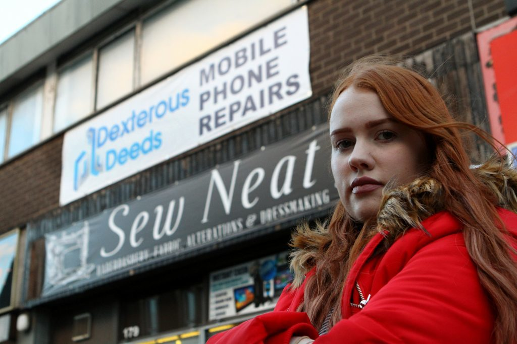Jaye Hudson outside the Dexterous Deeds shop in Lochee High Street.