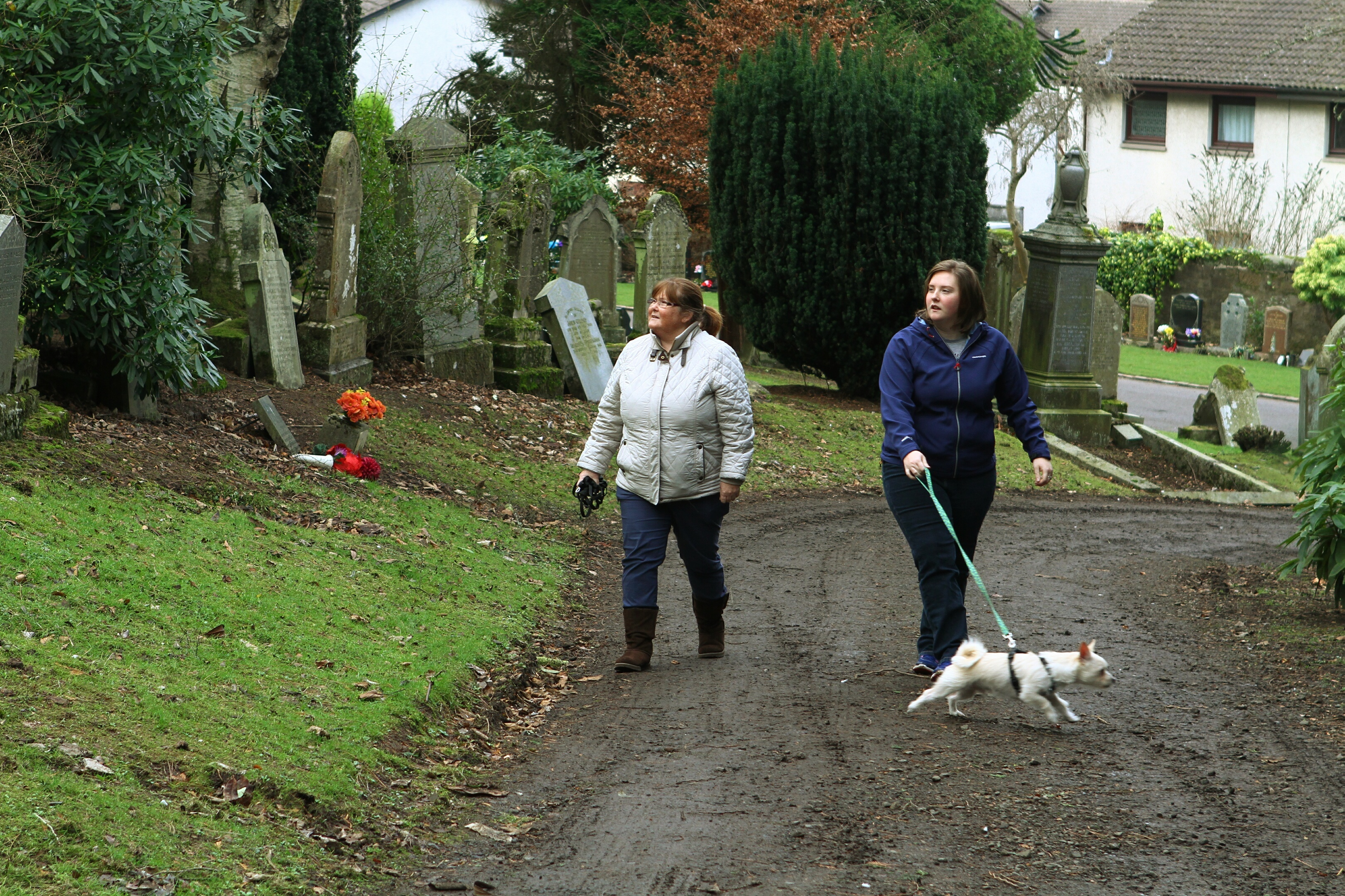 Helen Howie, left, and Ailsa Howie, with their dog Angus, helping in the search for Bella.