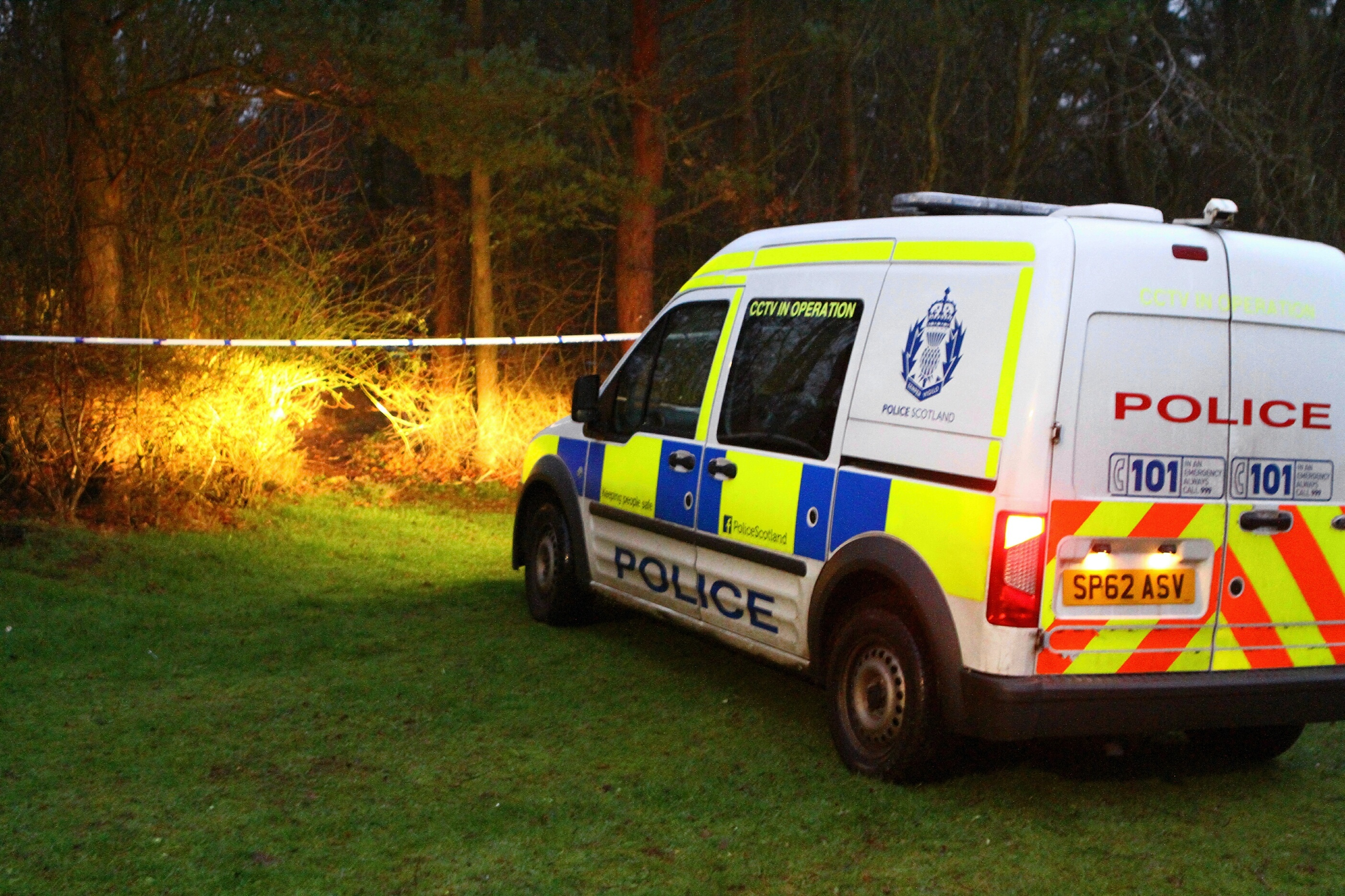 Police activity at the woodland behind the houses in Aboyne Way, where the body of a 52-year-old woman was found on Sunday morning.