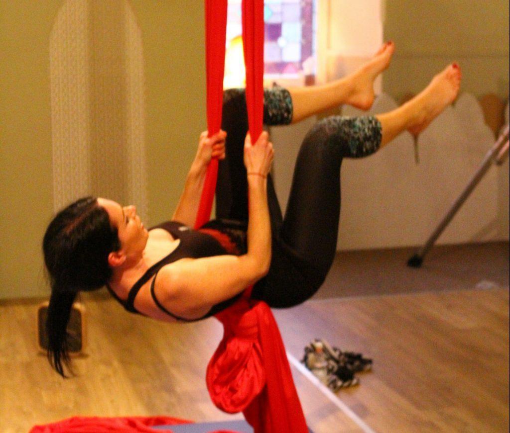 Gayle swings on the silk.
