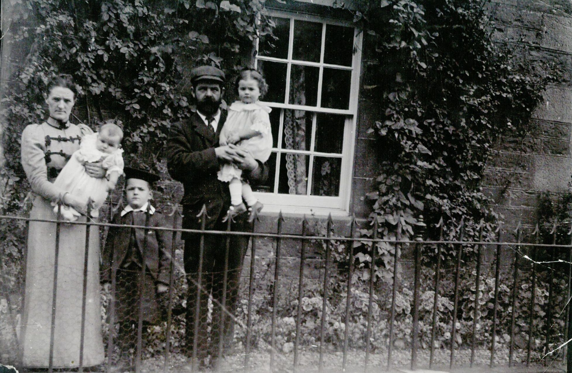 Jean's mother Jane in her father's arms, with her uncle George and baby Mary.