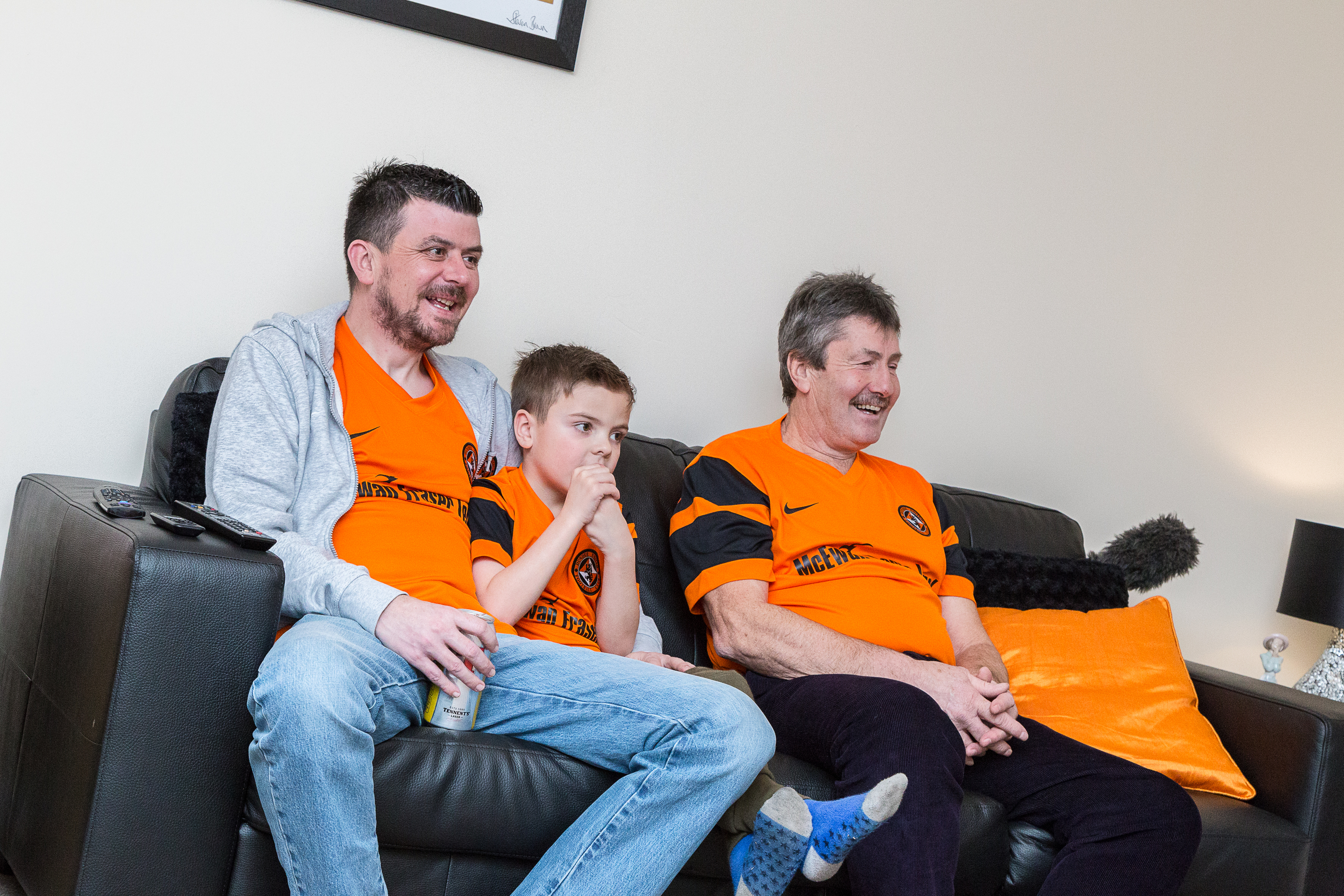 Utd legend Hamish watches the game with Martin and his son, also named Hamish.