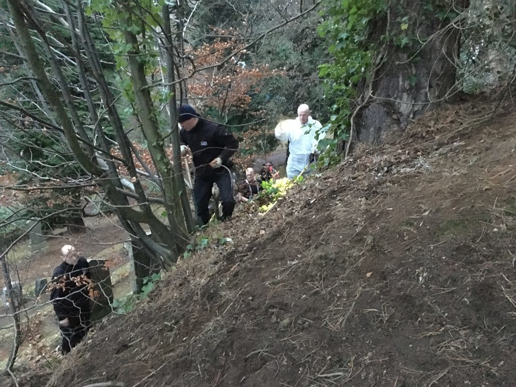 Rescuers dig for Bella.