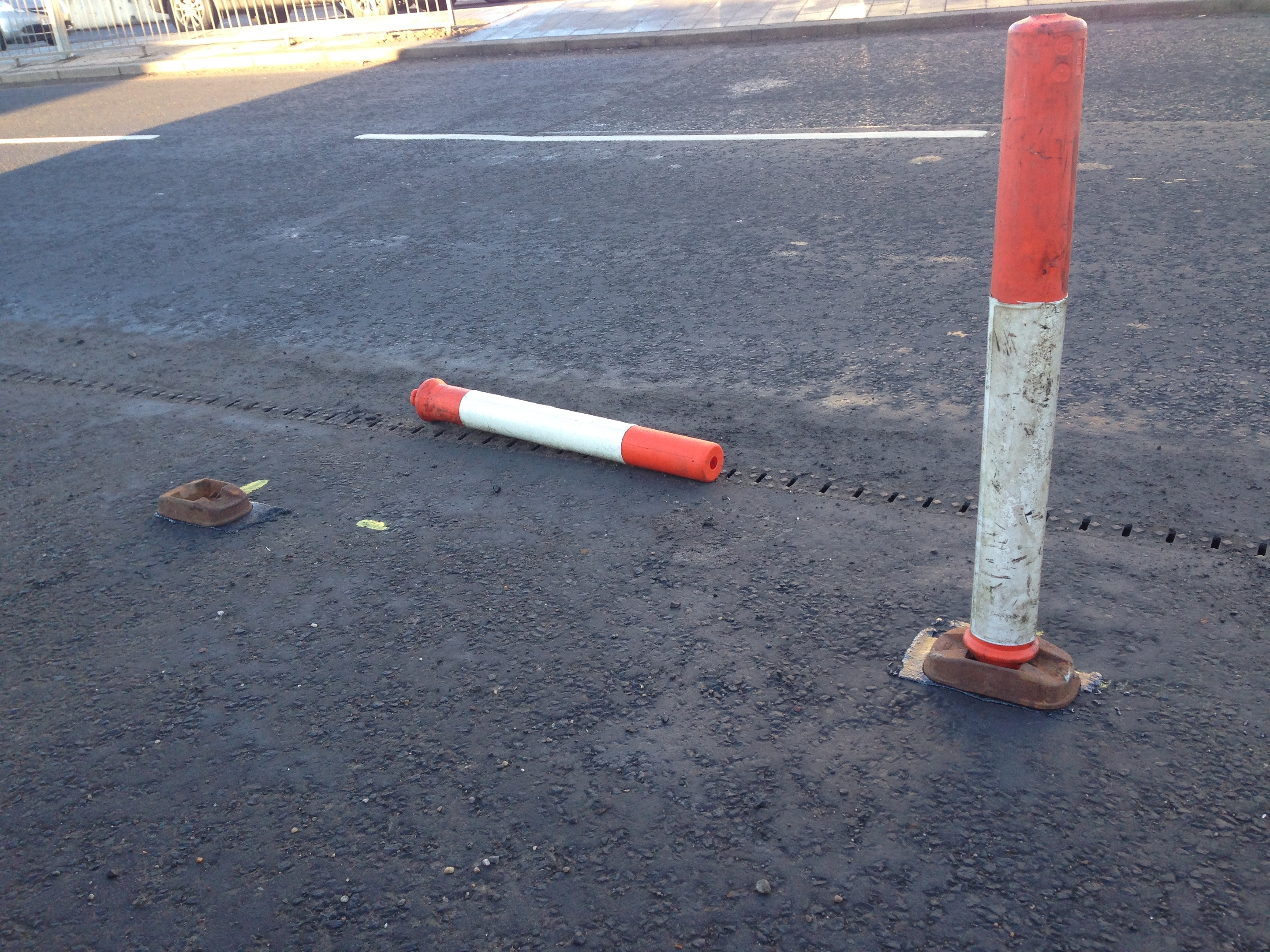 One of the bollards was removed from its base.
