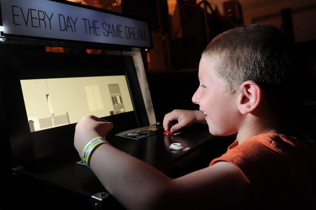 Douglas McAndrew playing one of the games at Dare ProtoPlay 2016.