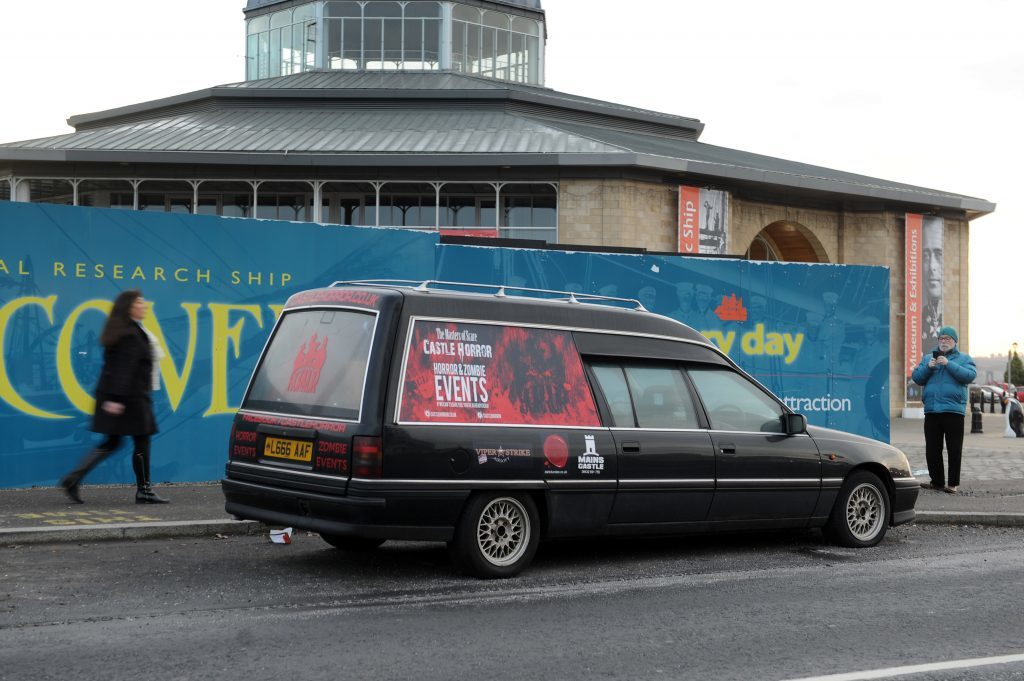 The hearse in the layby near the railway station.