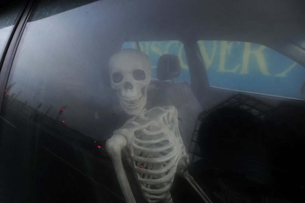 The hearse contains a mock skeleton.