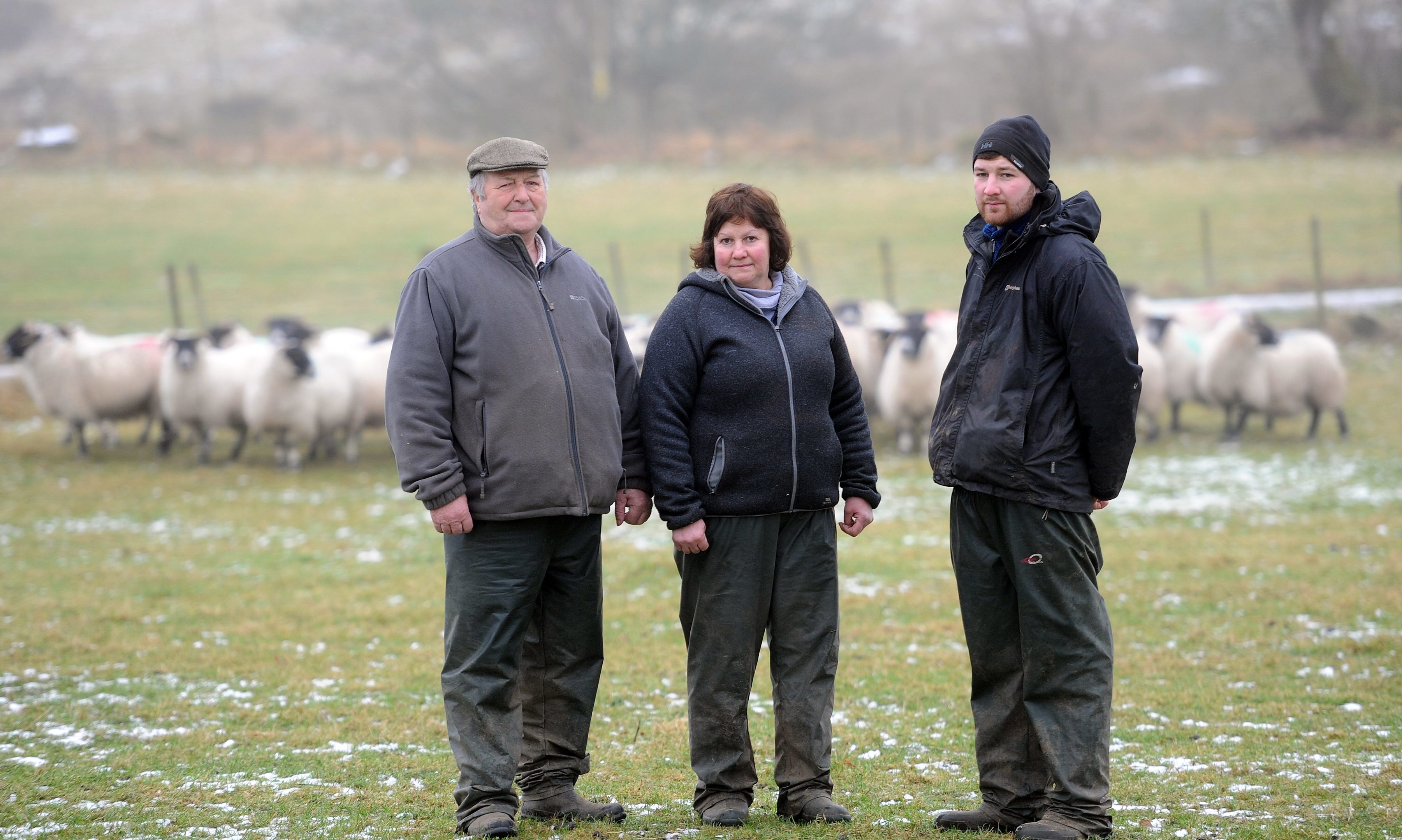Farmer Tom Paterson and his wife Mairi and son Robert. They saw the effects of sheep worrying first hand when their flock of prize sheep were attacked.