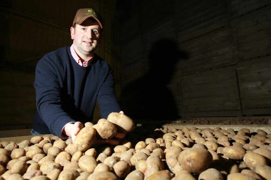 Graeme Jarron with some of the Maris Piper potatoes used to create Ogilvy Vodka.