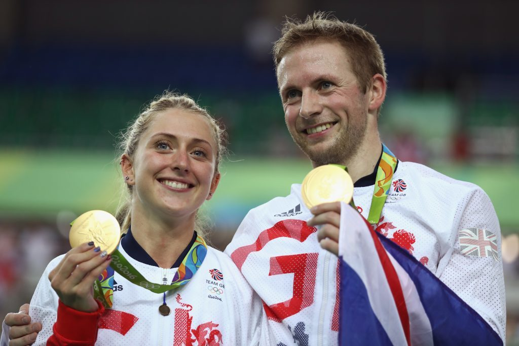 Gold medalist Jason Kenny of Great Britain celebrates with girlfriend, cycling gold medalist Laura Trott of Great Britain, during the medal ceremony after the Men's Keirin Finals race on Day 11 of the Rio 2016 Olympic Games at the Rio Olympic Velodrome in Rio de Janeiro, Brazil.
