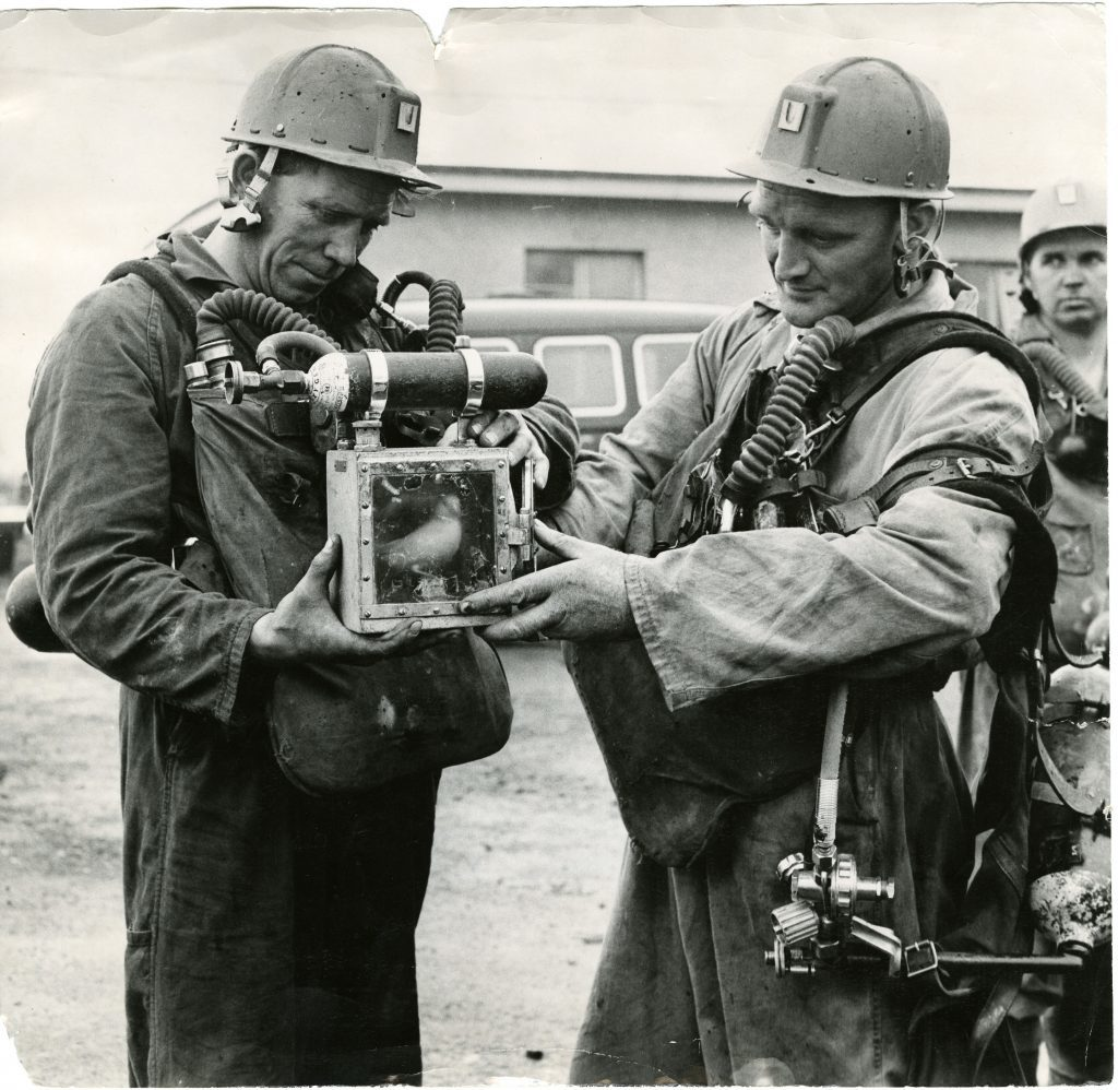 Rescue workers George Hastie and William Davie with one of the canaries which played a large part in rescue operations.