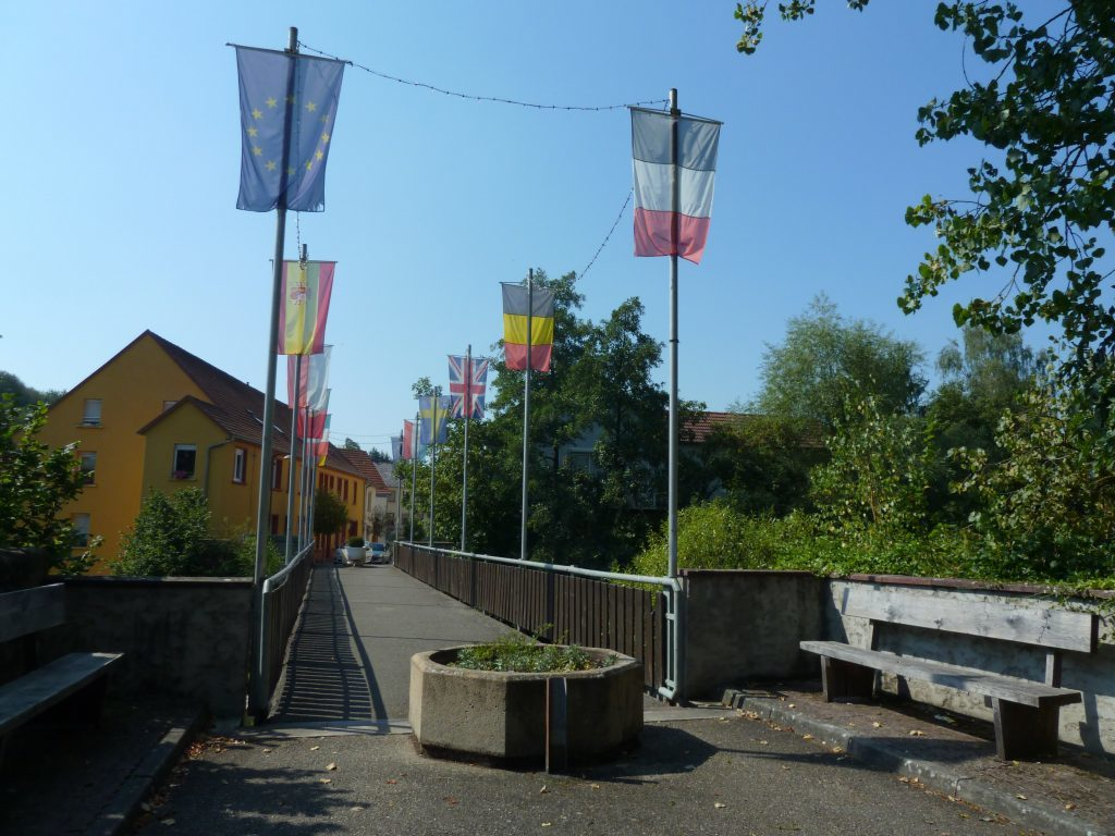 The Union flag flying among the others of Europe on a bridge between Germany and France.