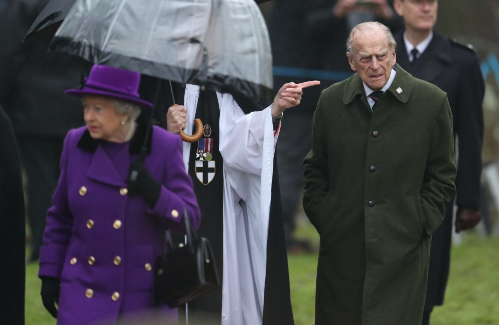 Queen Elizabeth II and the Duke of Edinburgh depart after attending a church service at Flitcham church in the village of Flitcham in Norfolk.