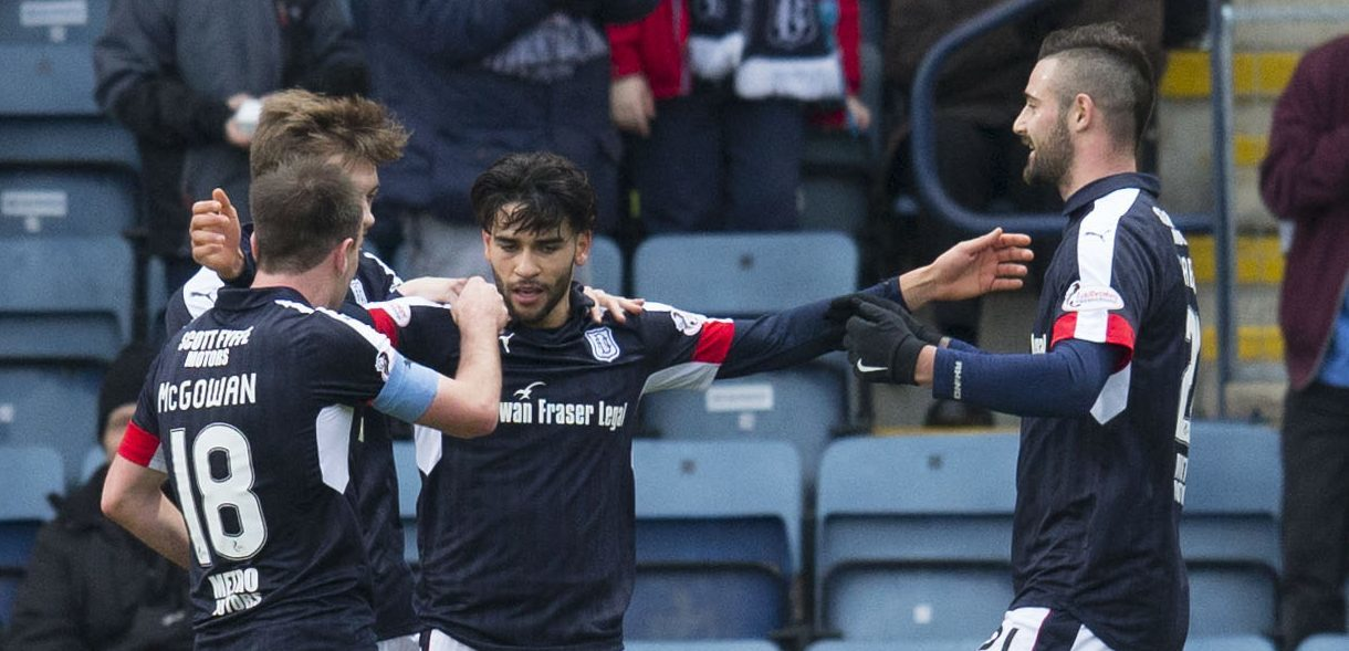 Faissal El Bakhtaoui, centre, is congratulated by his team-mates after opening the scoring.