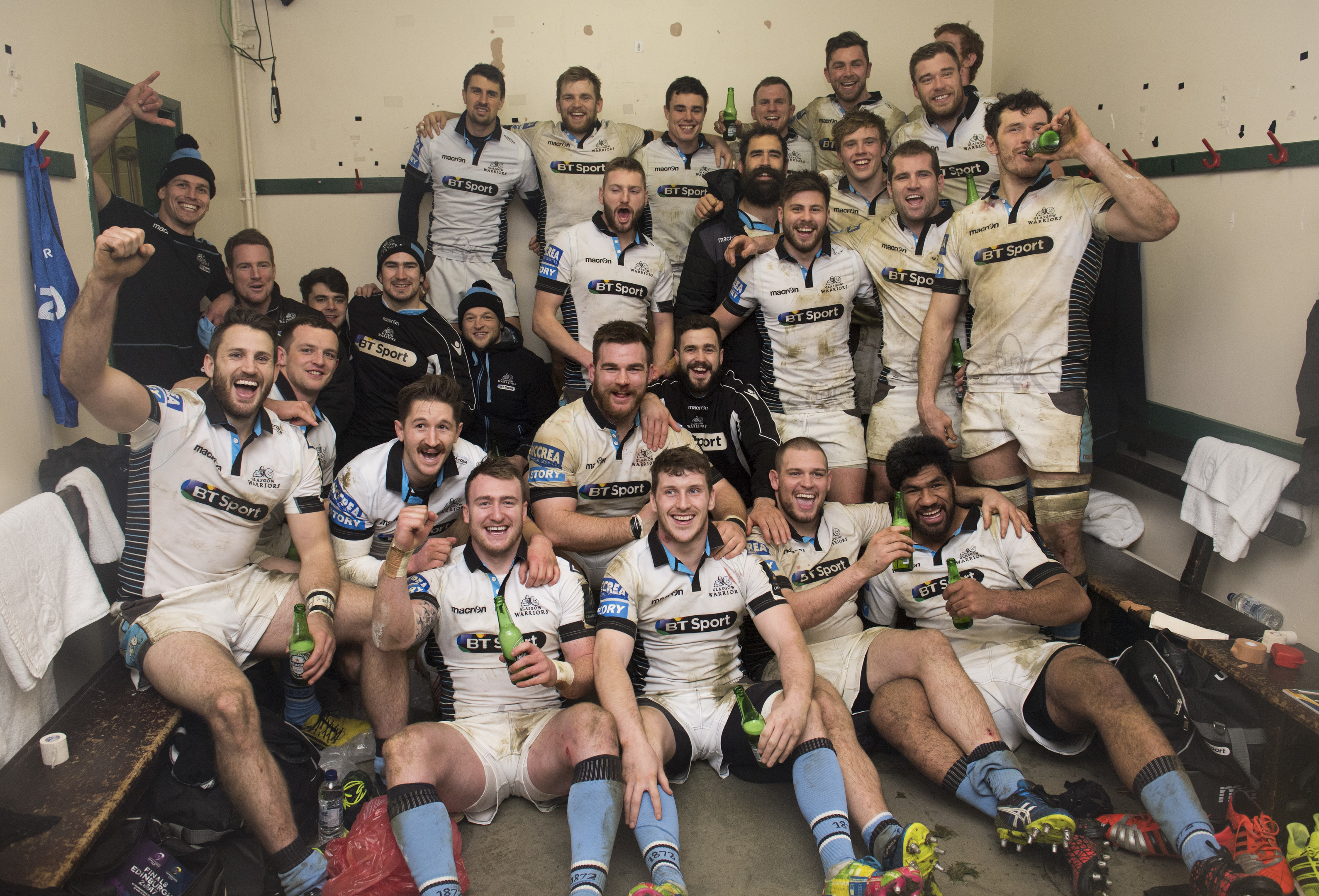 Glasgow celebrate in their Welford Road dressing room after their 43-0 rout of Leicester.