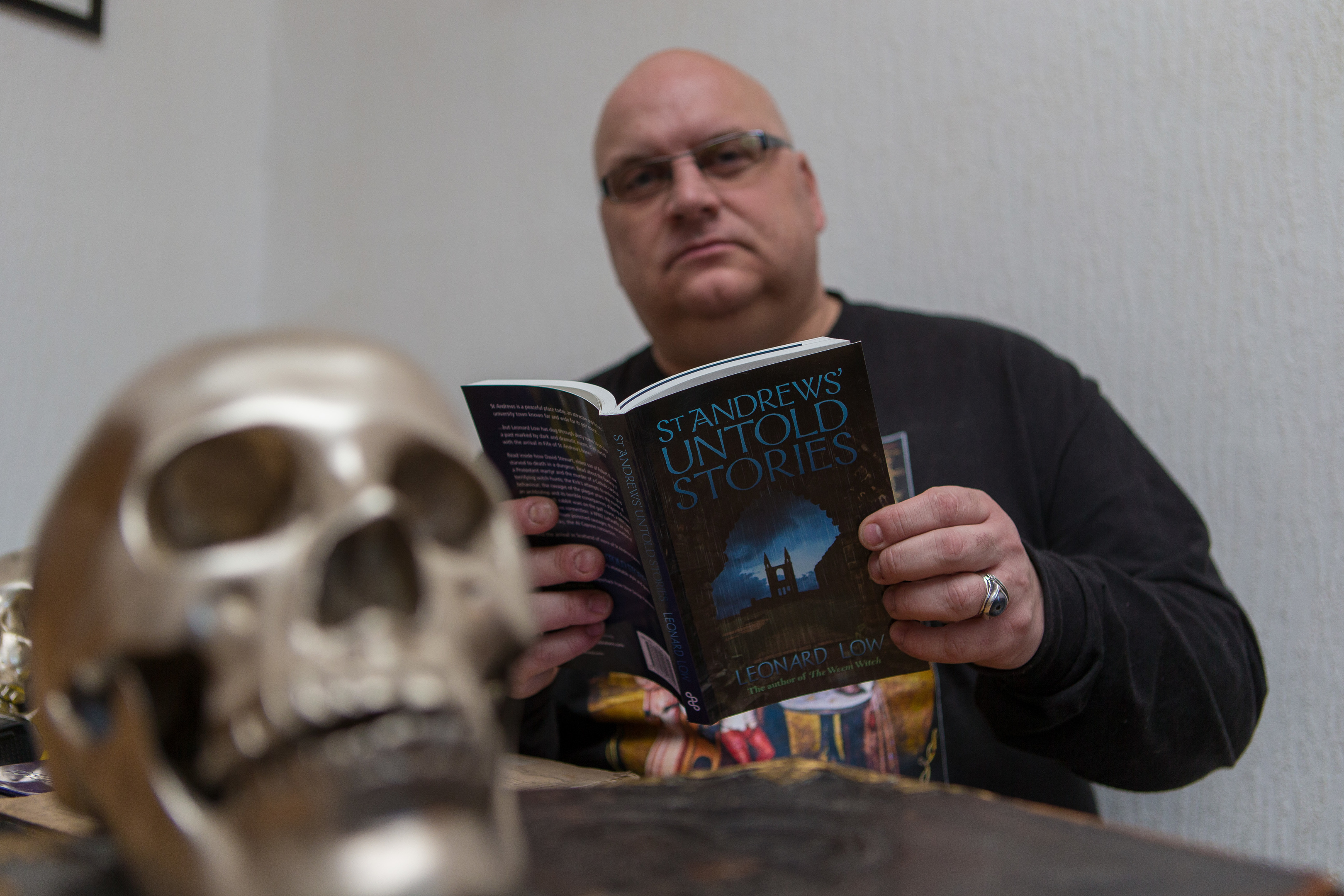 Author Leonard Low with another of his books.