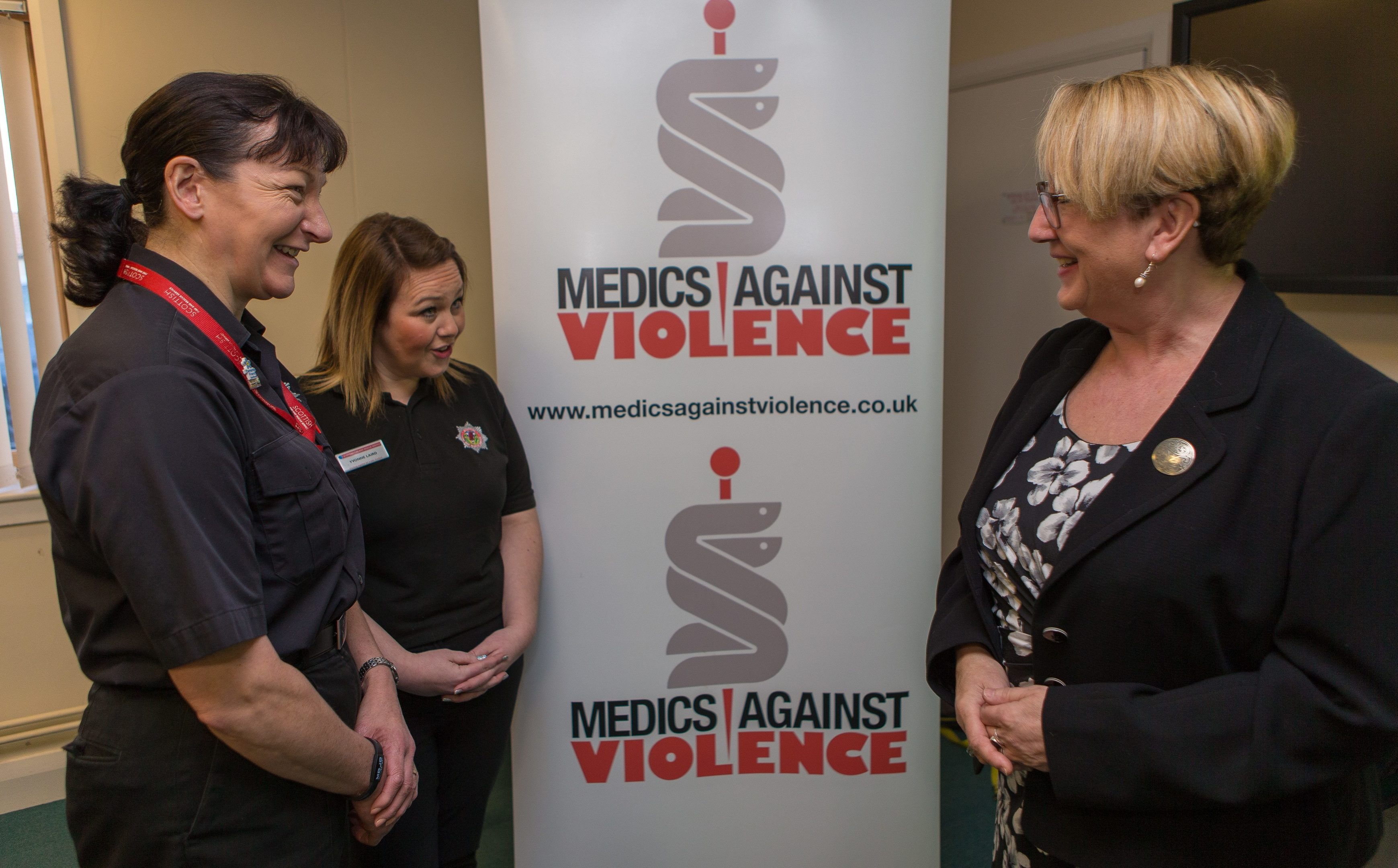Yvonne Laird and Heather Steele of Fire Scotland speak to MSP Annabelle Ewing.