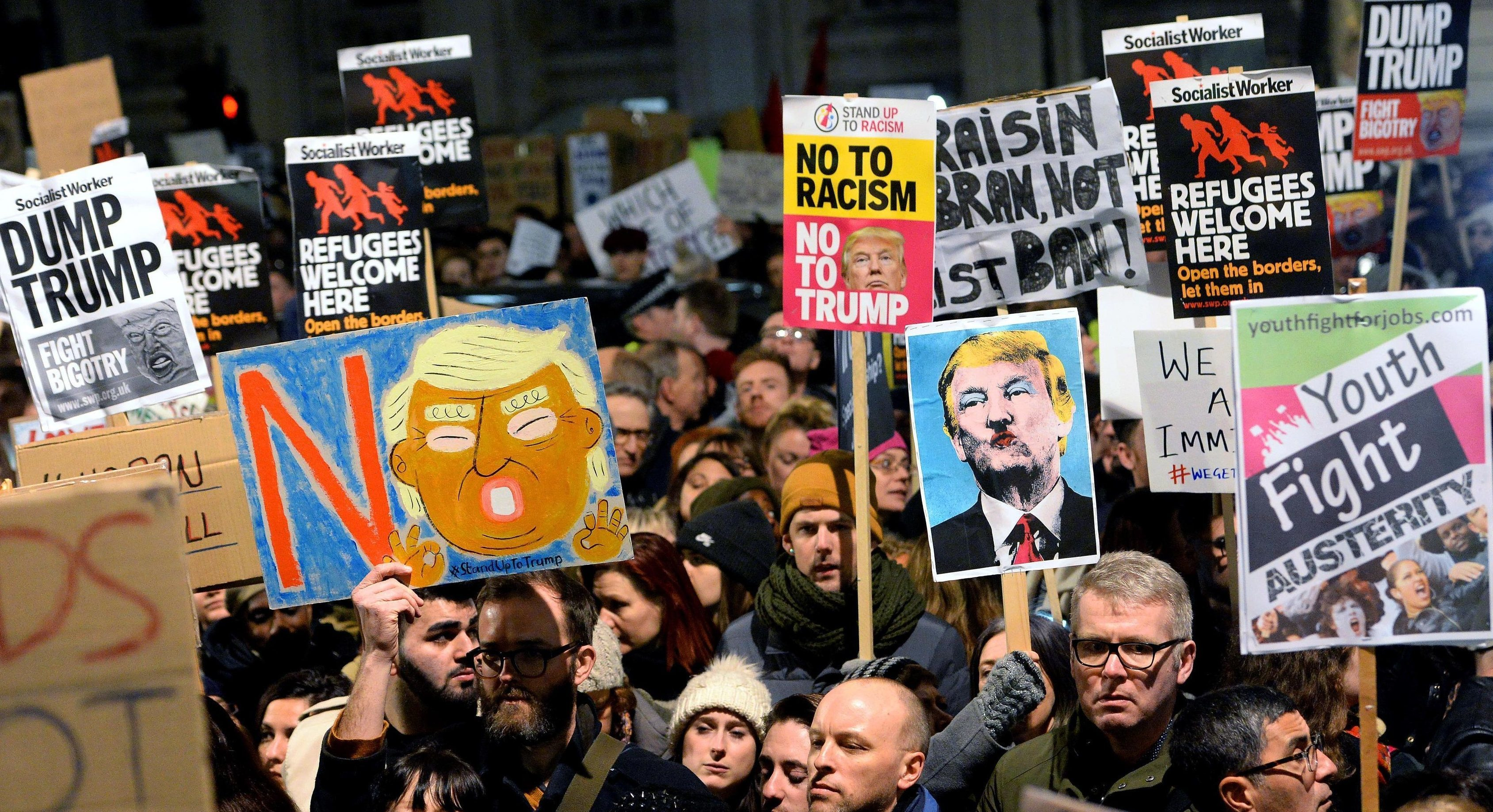 People protest against Donald Trump's controversial travel ban.