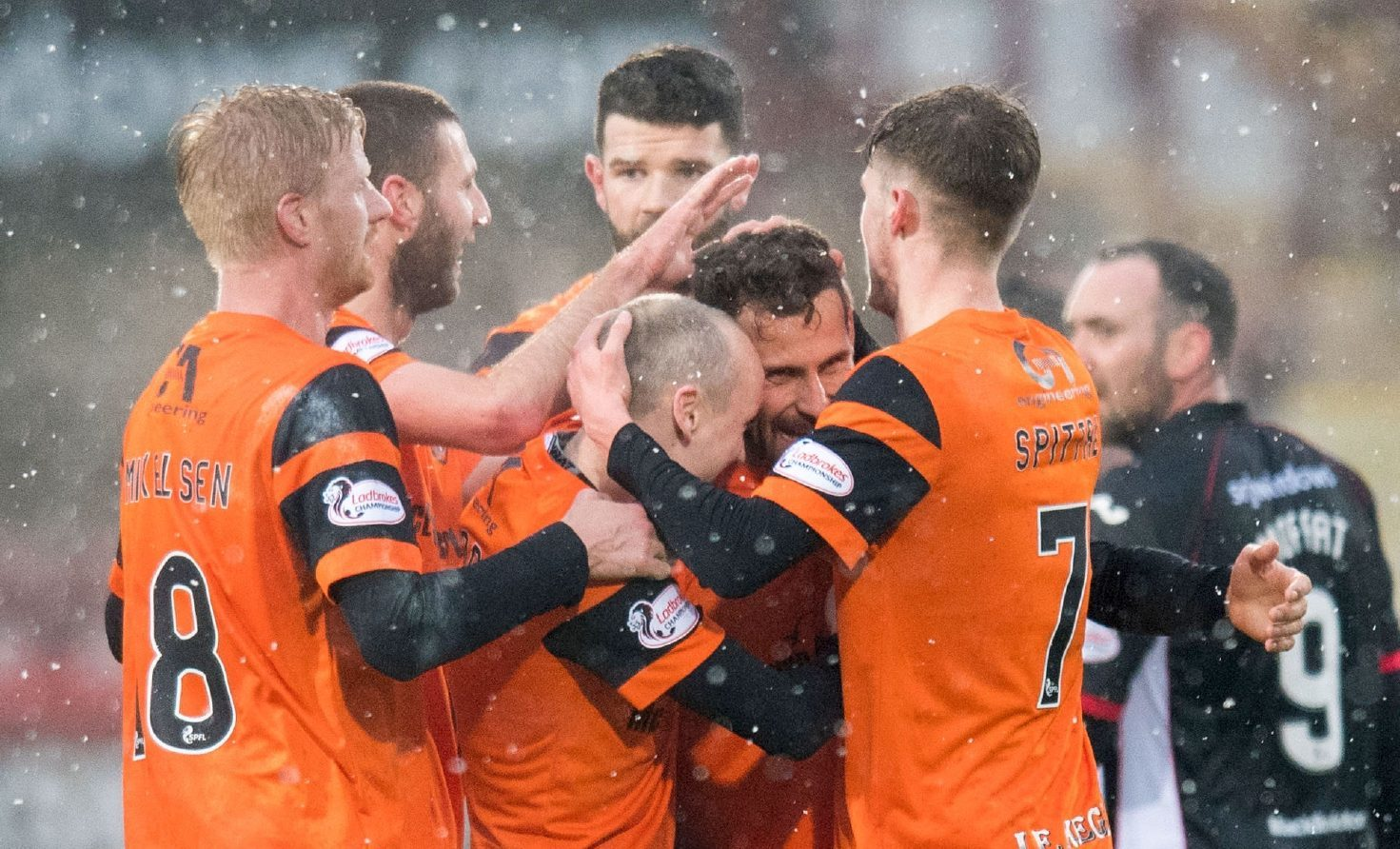 Tony Andreu is mobbed by his team-mates after scoring his stunning goal.