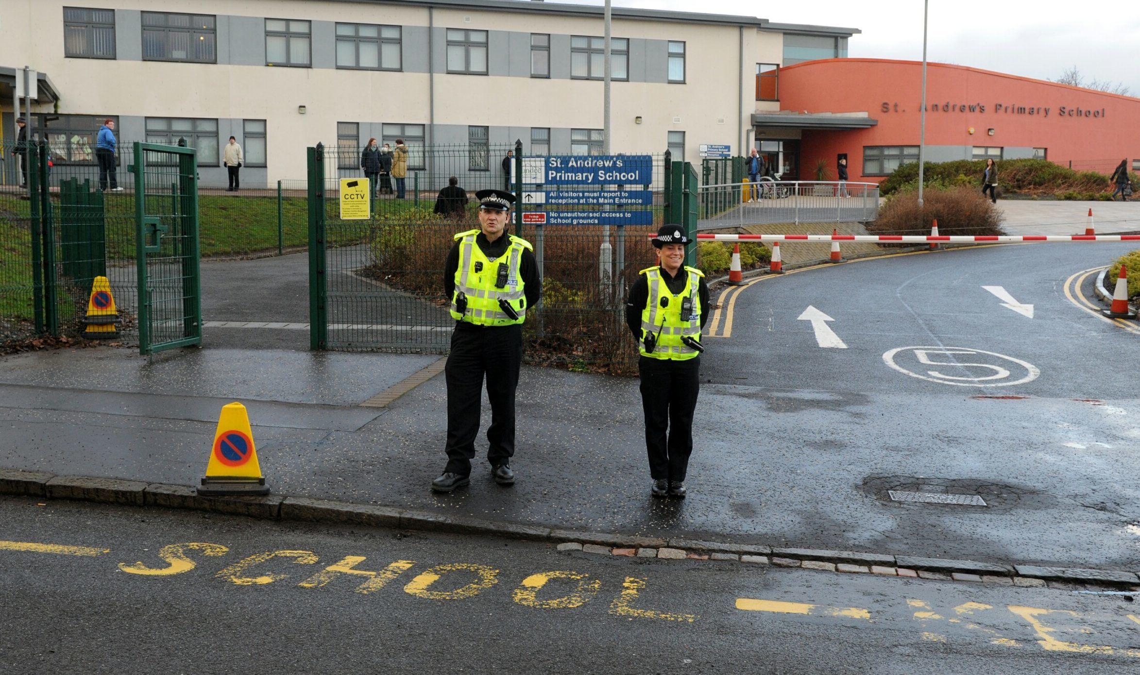 Police monitor parking outside St Andrews Primary.