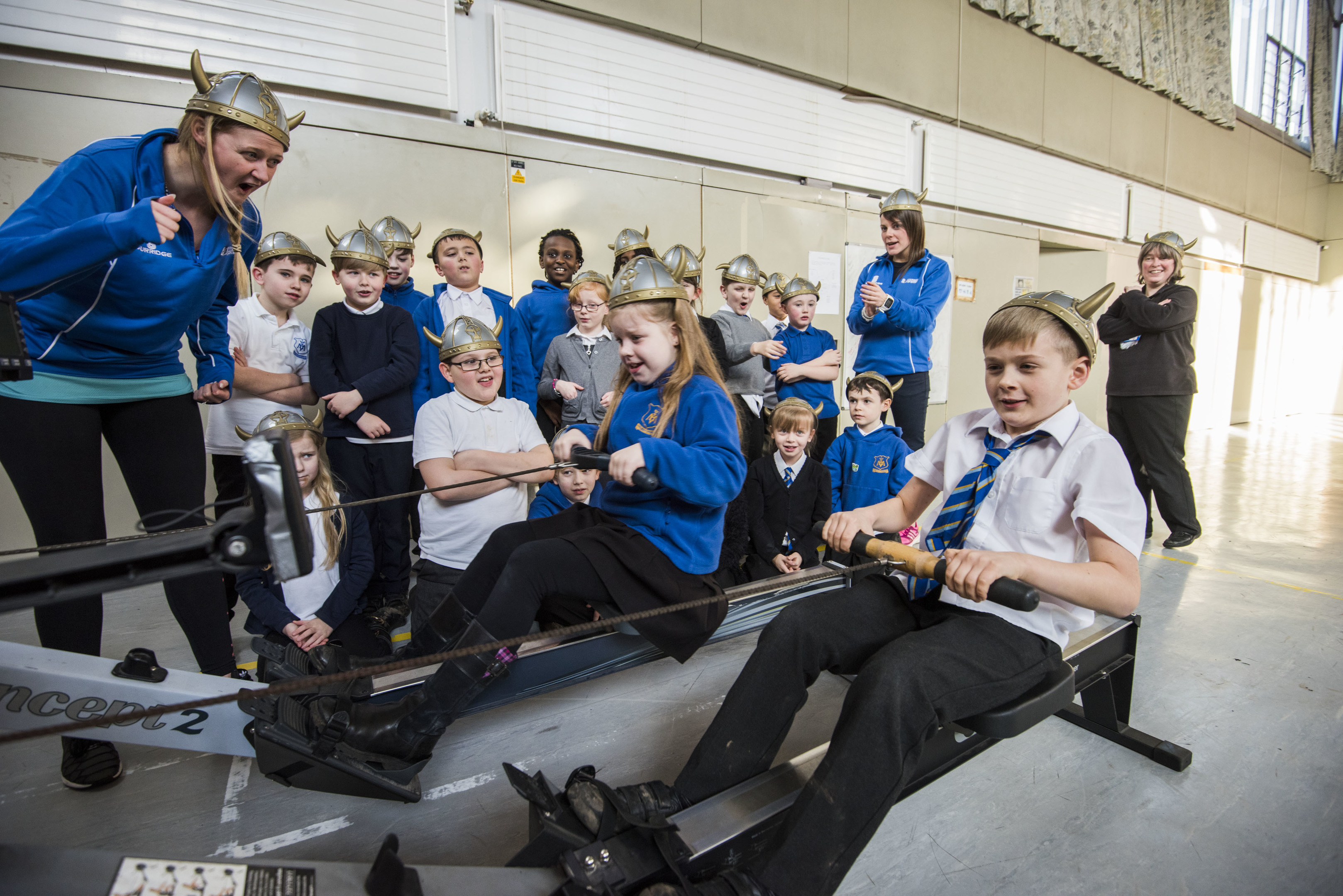 Children from Our Lady's Primary school being taught about Viking history while exercising on a rowing machine.