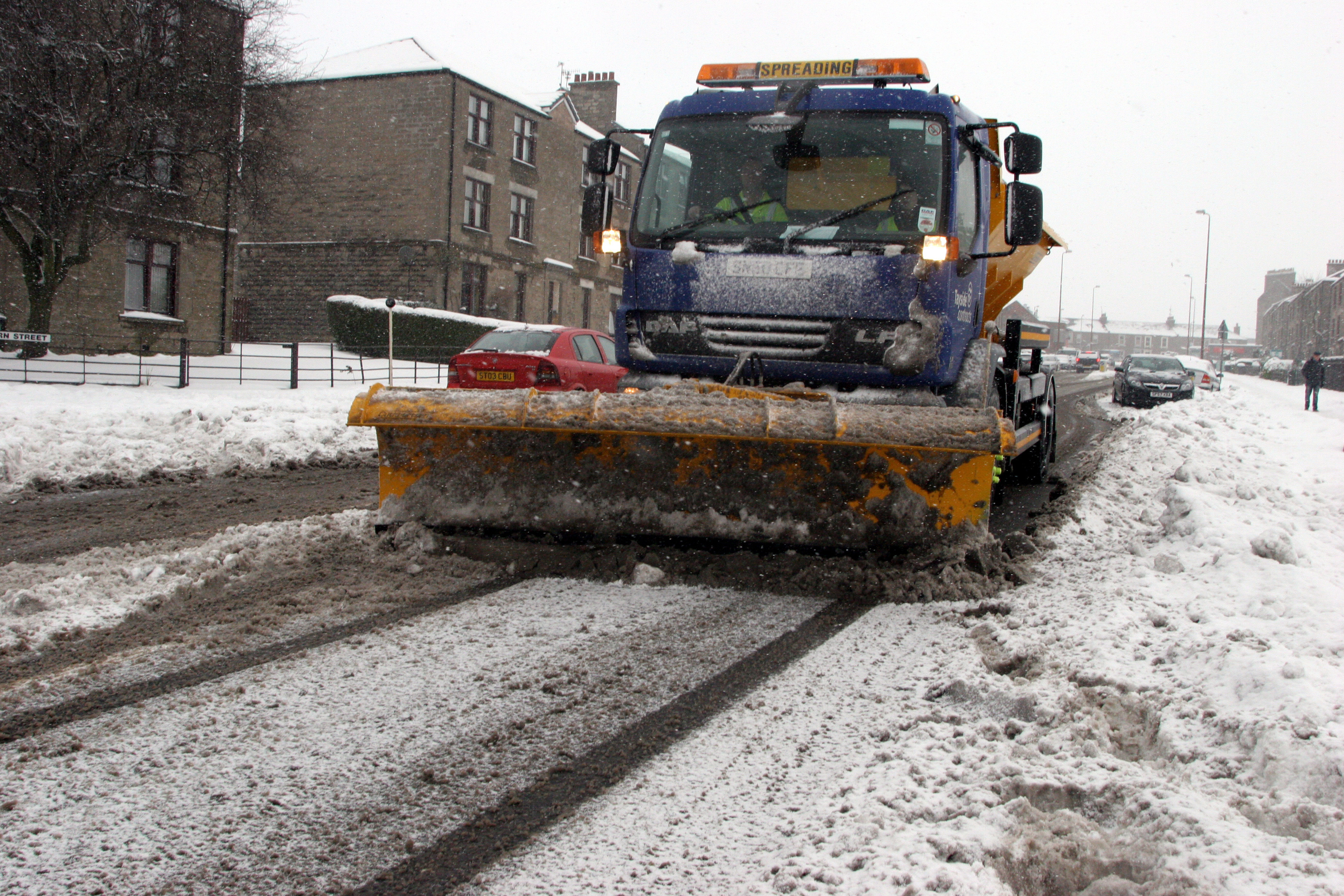 "A council snow-plough clearing the roads during 2010's ""Big Freeze"""