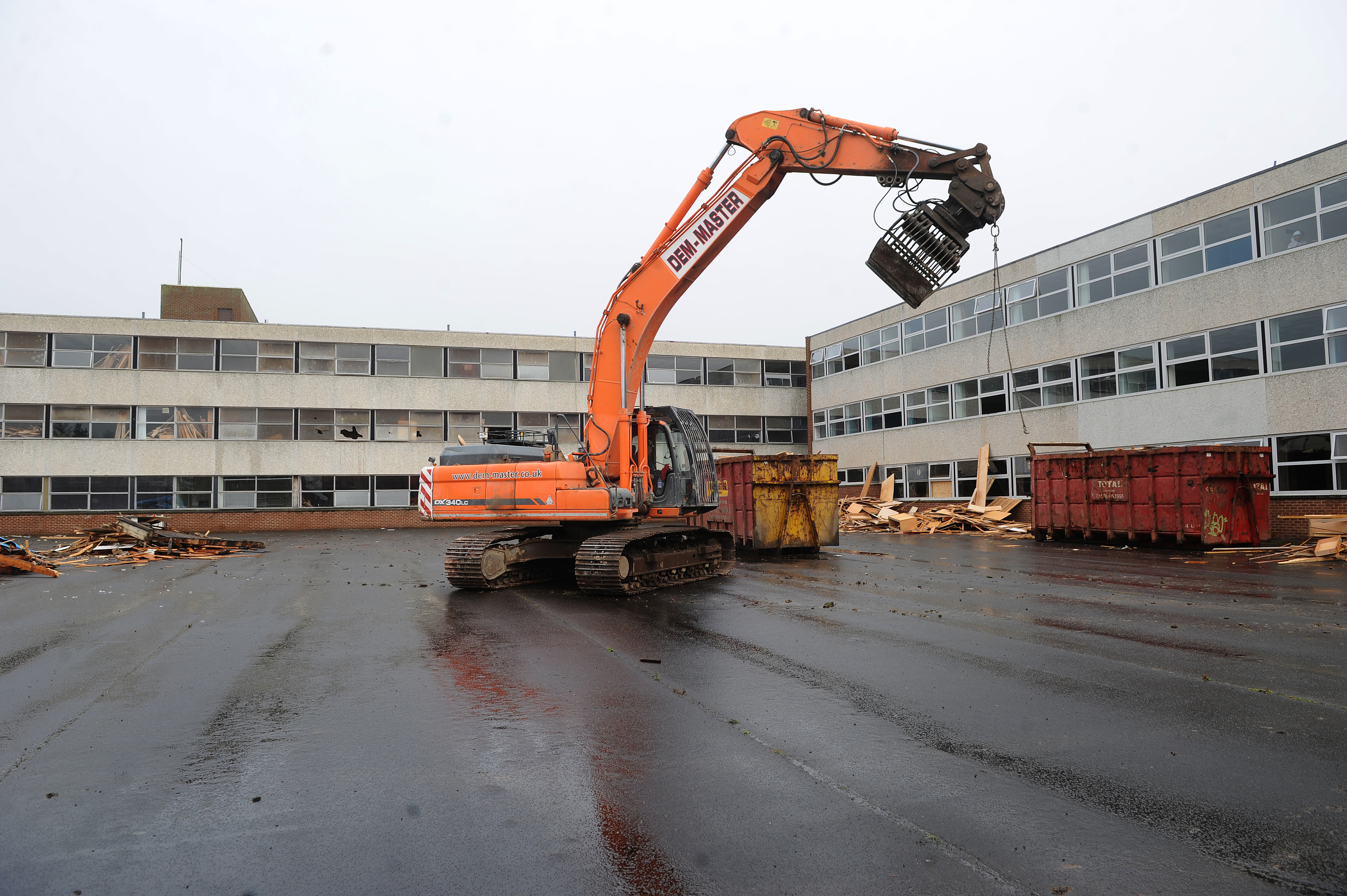 Demolition machinery hard at work on the site of the former school.