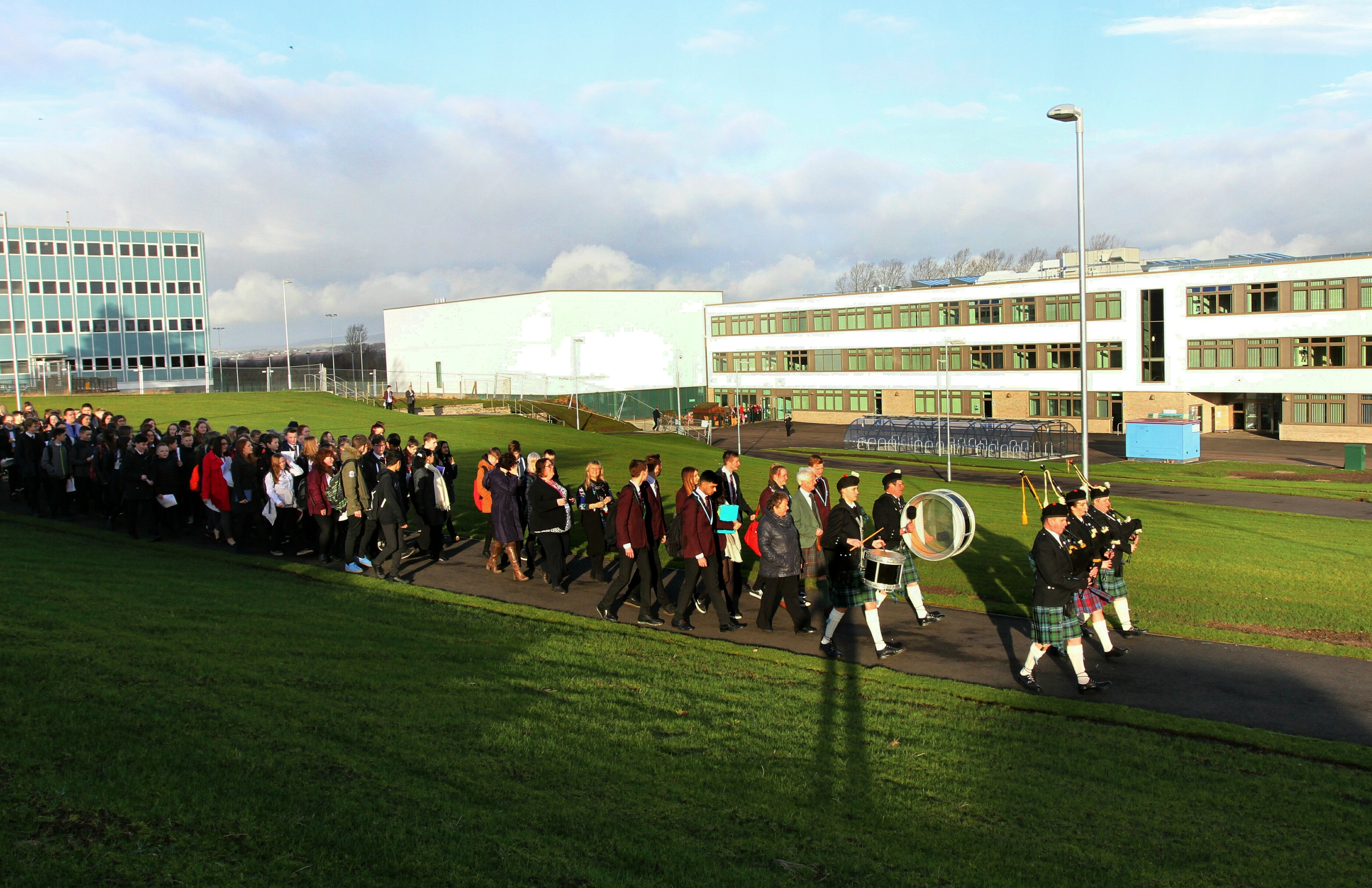 Pupils were ceremonially piped from the old school (left) to the new when it opened for lessons.